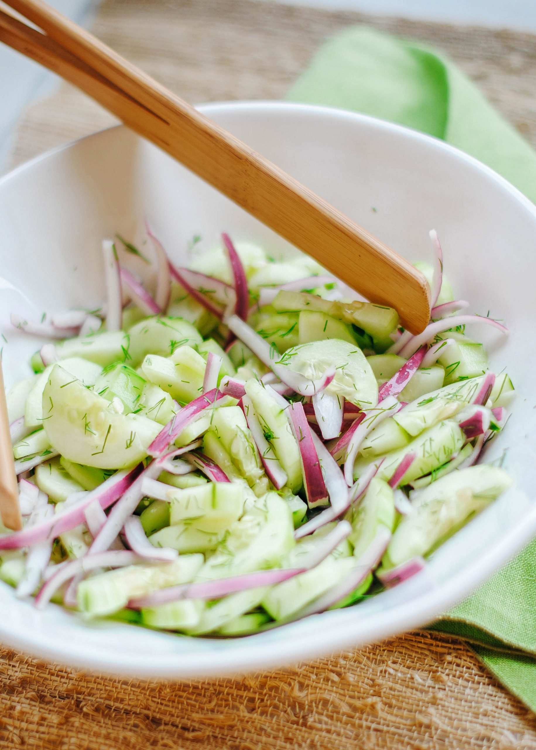 Fresh and crisp Sweet Cucumber, Red Onion and Dill Salad made with 5 simple ingredients and the perfect recipe for the summer!
