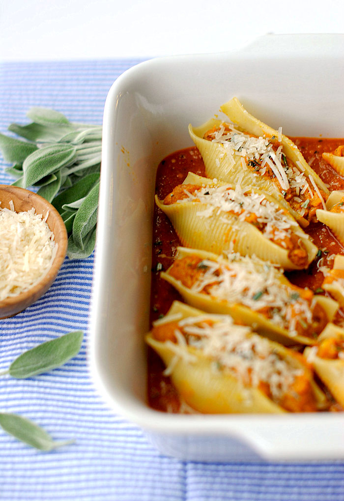 These Pumpkin and Sage Stuffed Shells are the perfect Fall recipe with flavors like cinnamon and nutmeg and less than 300 calories per serving!