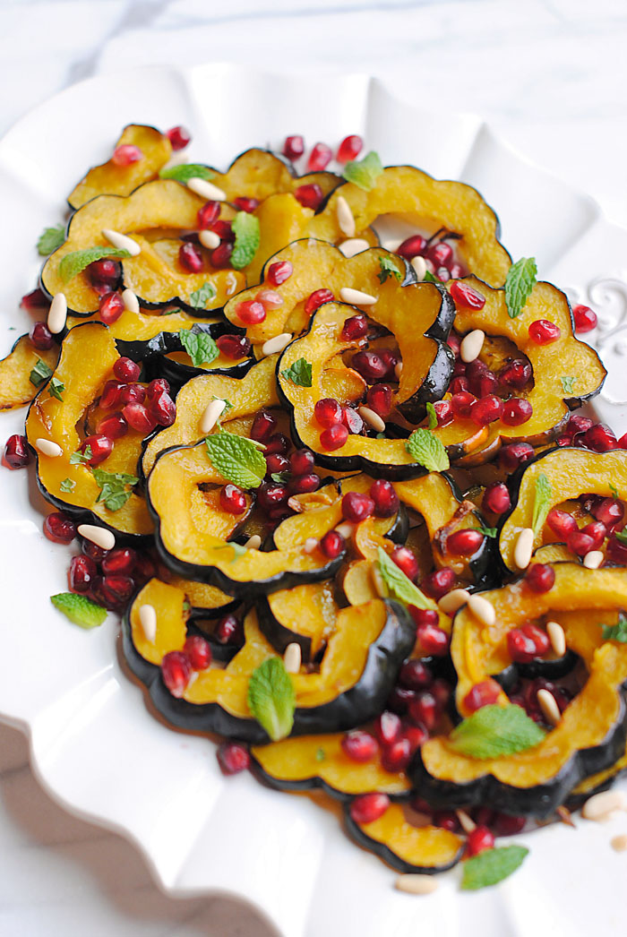 This Holiday Glazed Acorn Squash with Pomegranates and Pine Nuts is the perfect healthy side dish for your table this season!
