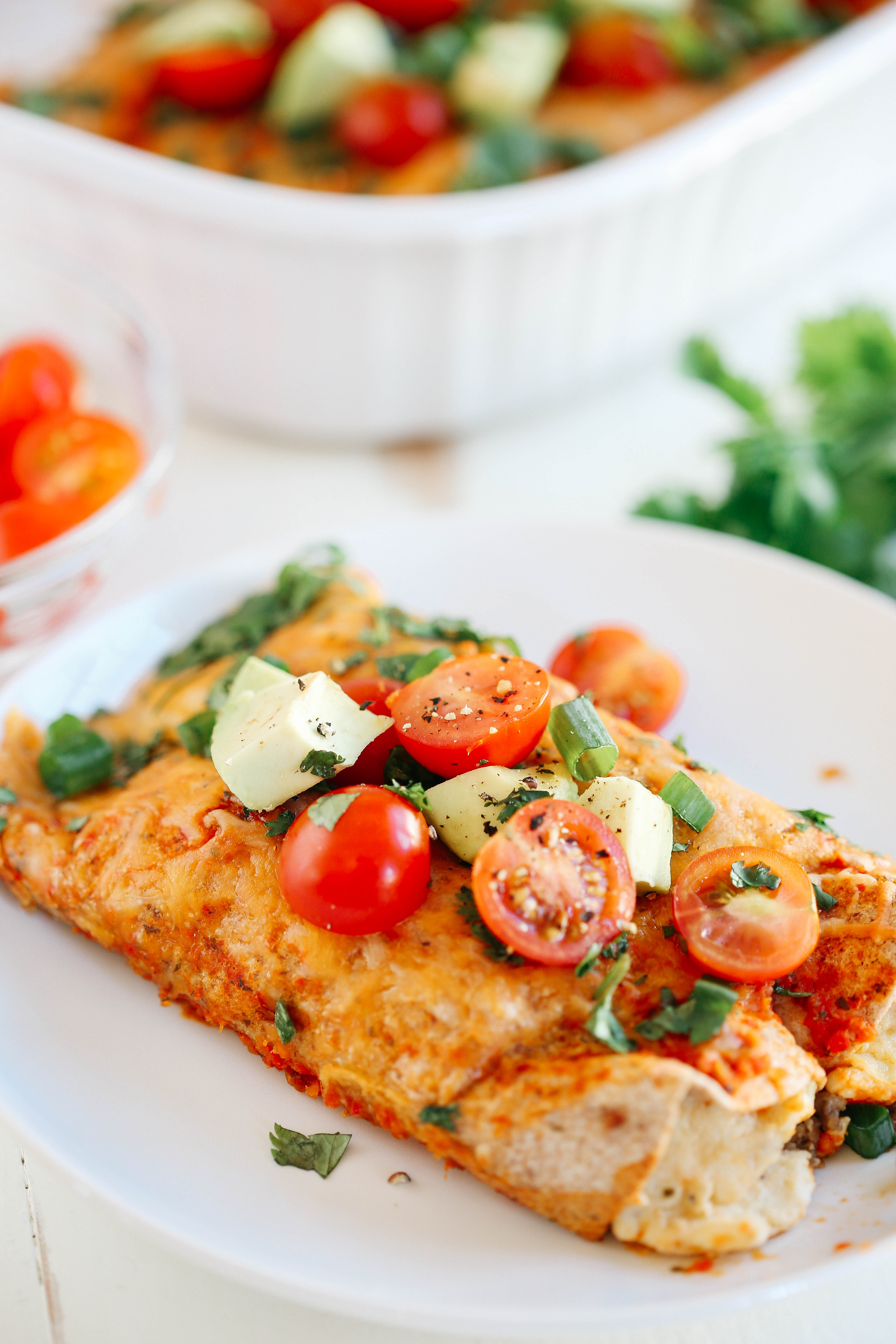 Healthy Breakfast Enchiladas that are cheesy, spicy and full of so much flavor and can easily be prepped ahead of time for a quick delicious breakfast!
