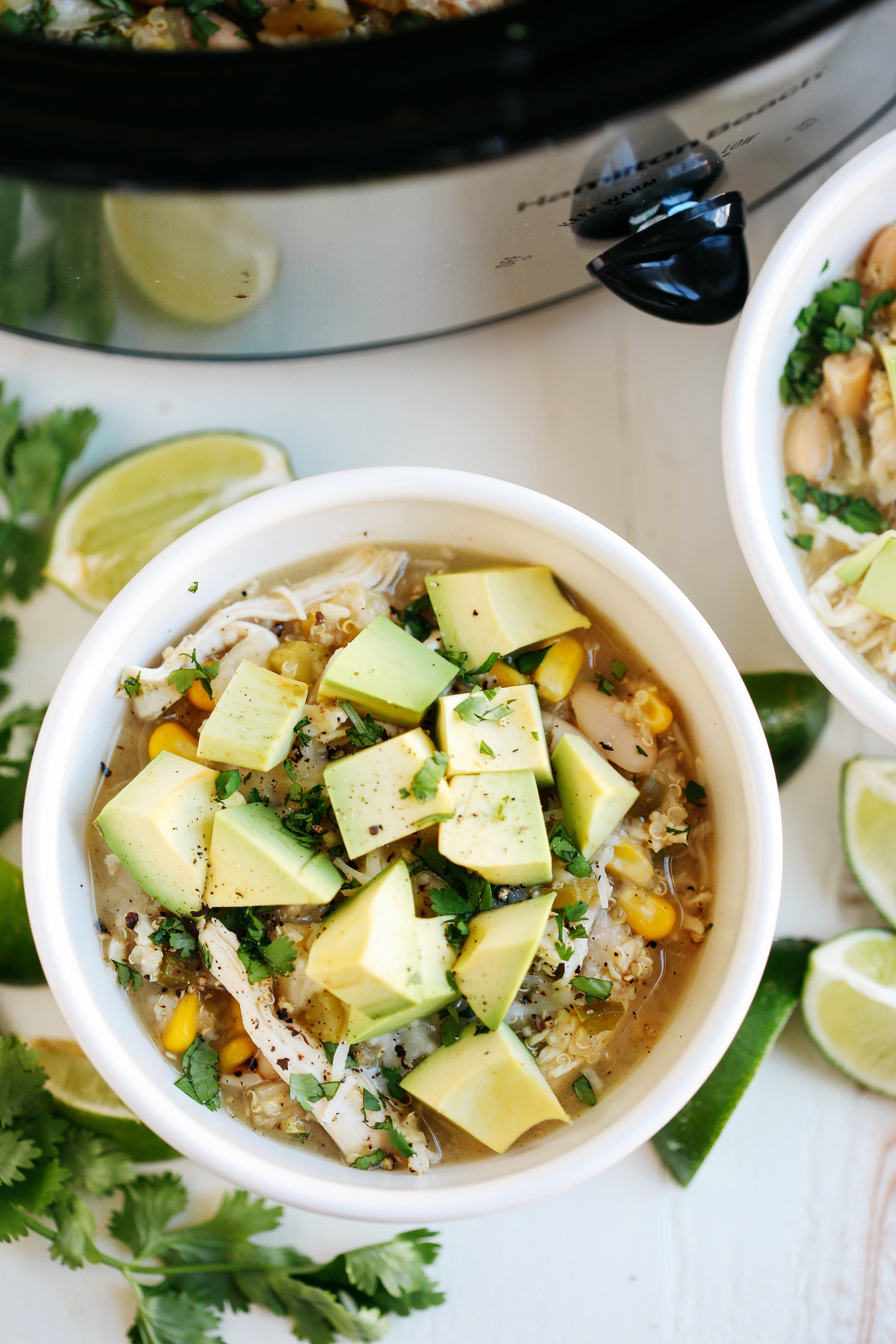 This Slow Cooker White Chicken and Quinoa Chili is the perfect blend of hearty and healthy that will keep you warm and cozy all winter long!