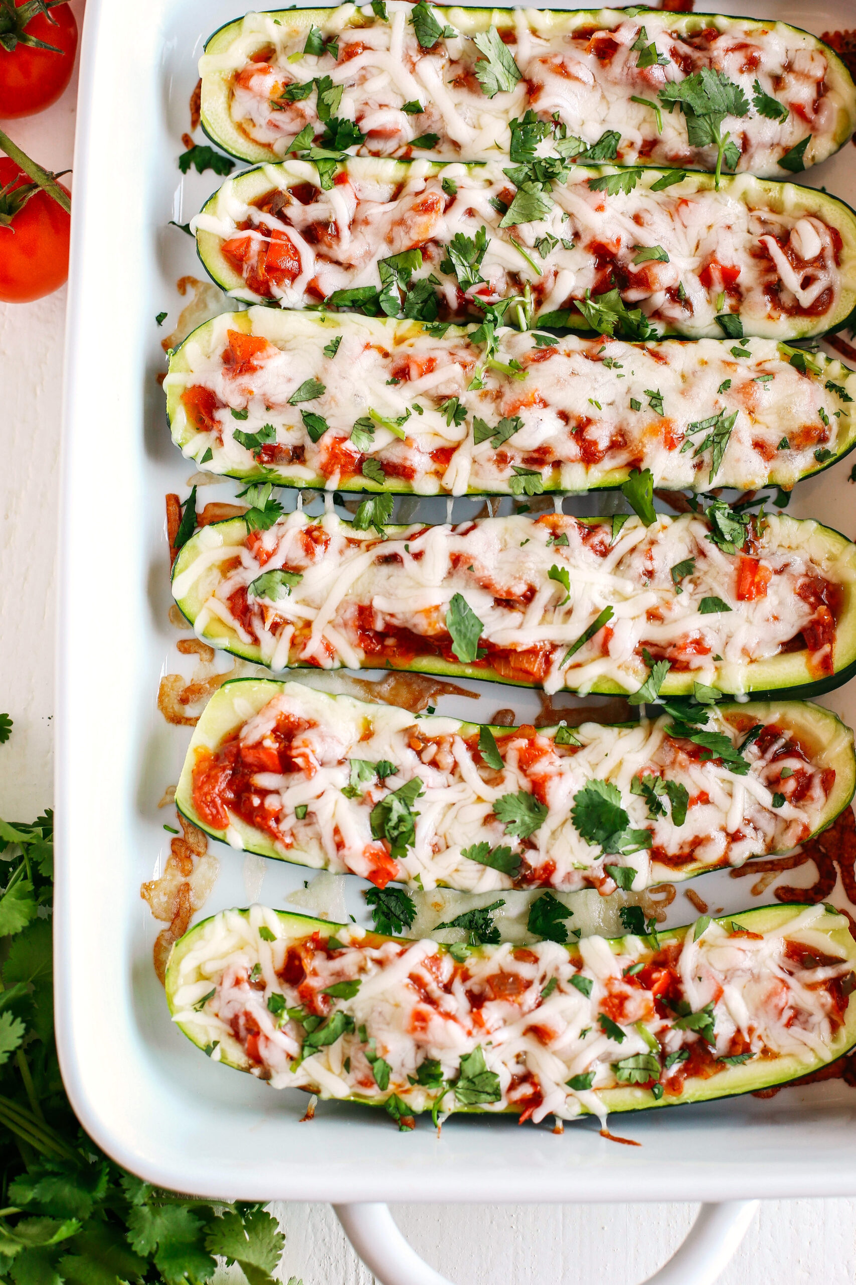 These Enchilada Stuffed Zucchini Boats are super flavorful, easy to make and are a much healthier alternative to regular enchiladas!