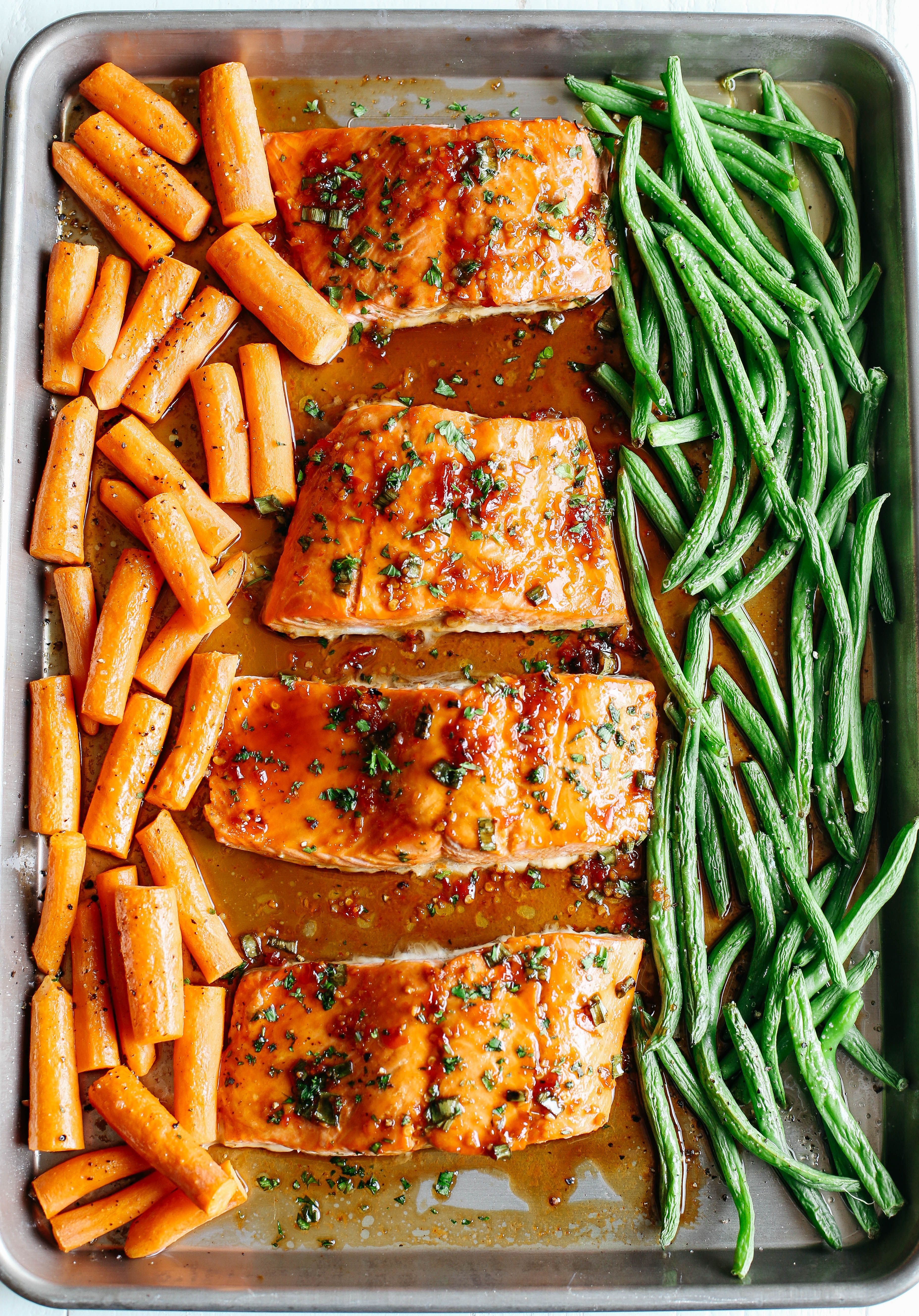 This Sheet Pan Ginger Soy Glazed Salmon makes the perfect weeknight dinner that's quick, healthy and easily made all on one pan!
