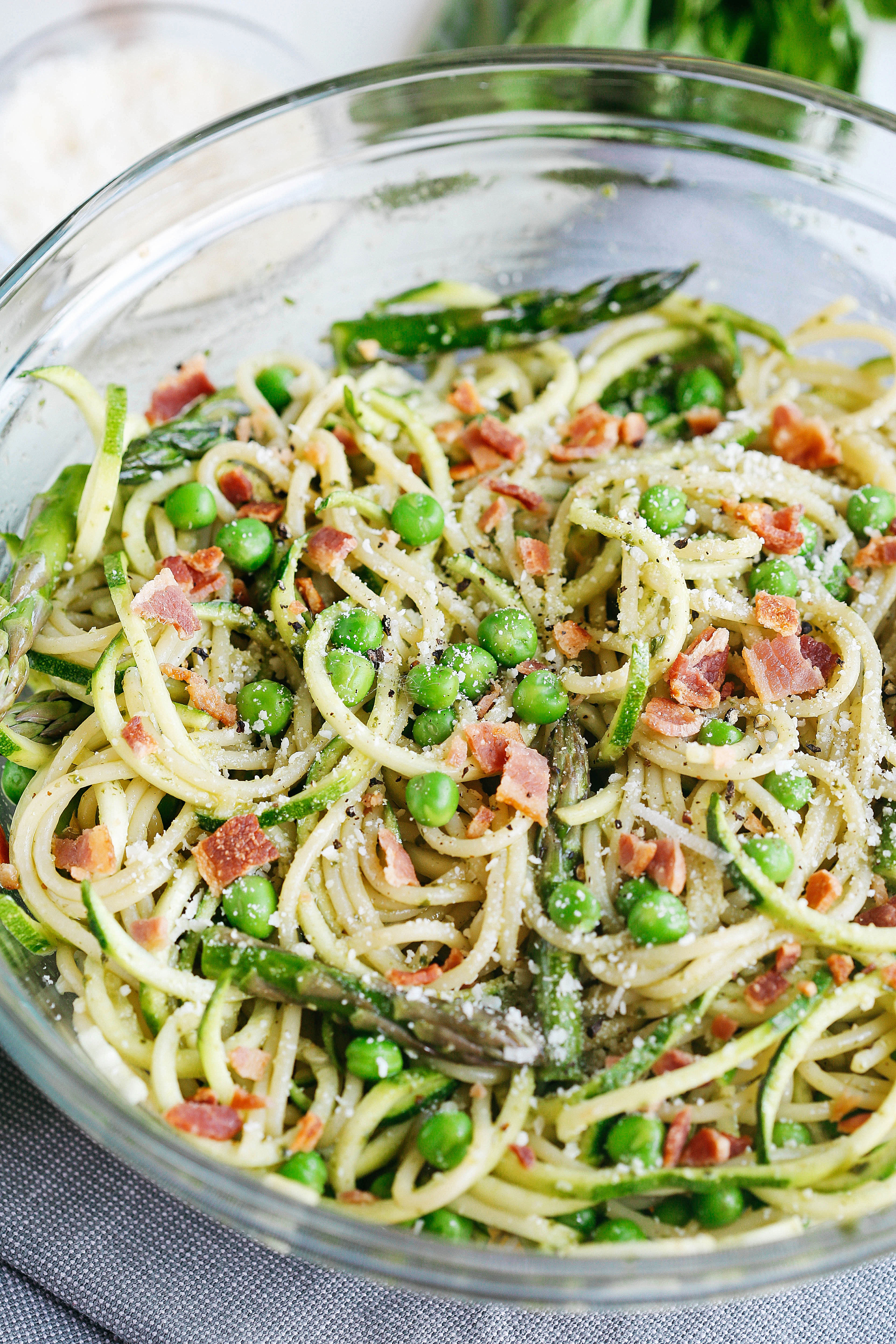 This delicious pasta salad is a lighter take on your favorite summer side dish that is loaded with fresh veggies and crunchy bacon all tossed together with a sweet basil vinaigrette for a meal that is both healthy and comfort food all in one!