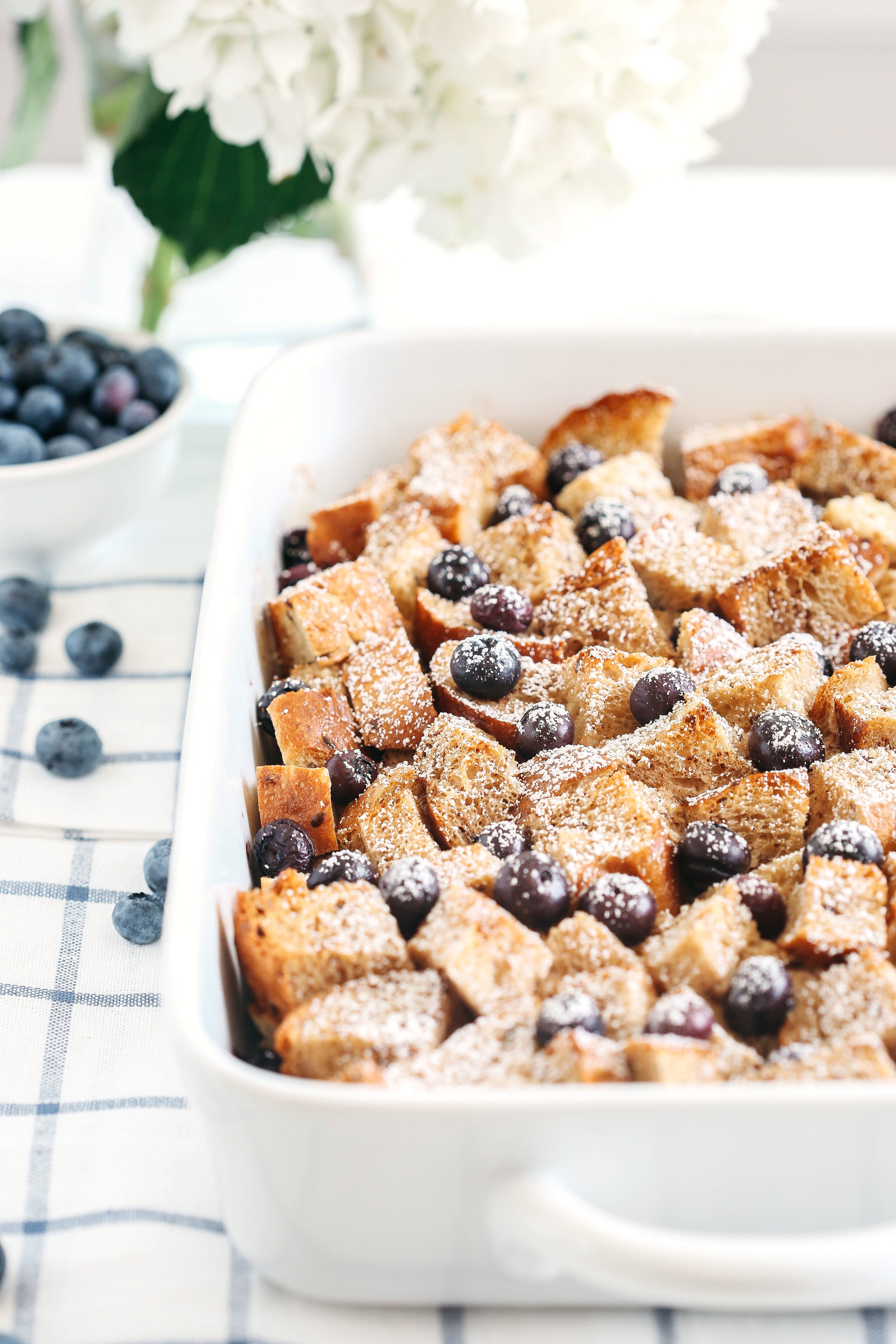 Warm and delicious Overnight Blueberry French Toast Casserole that is lighter in calories, high in protein and can easily be made the night before for the perfect morning breakfast!
