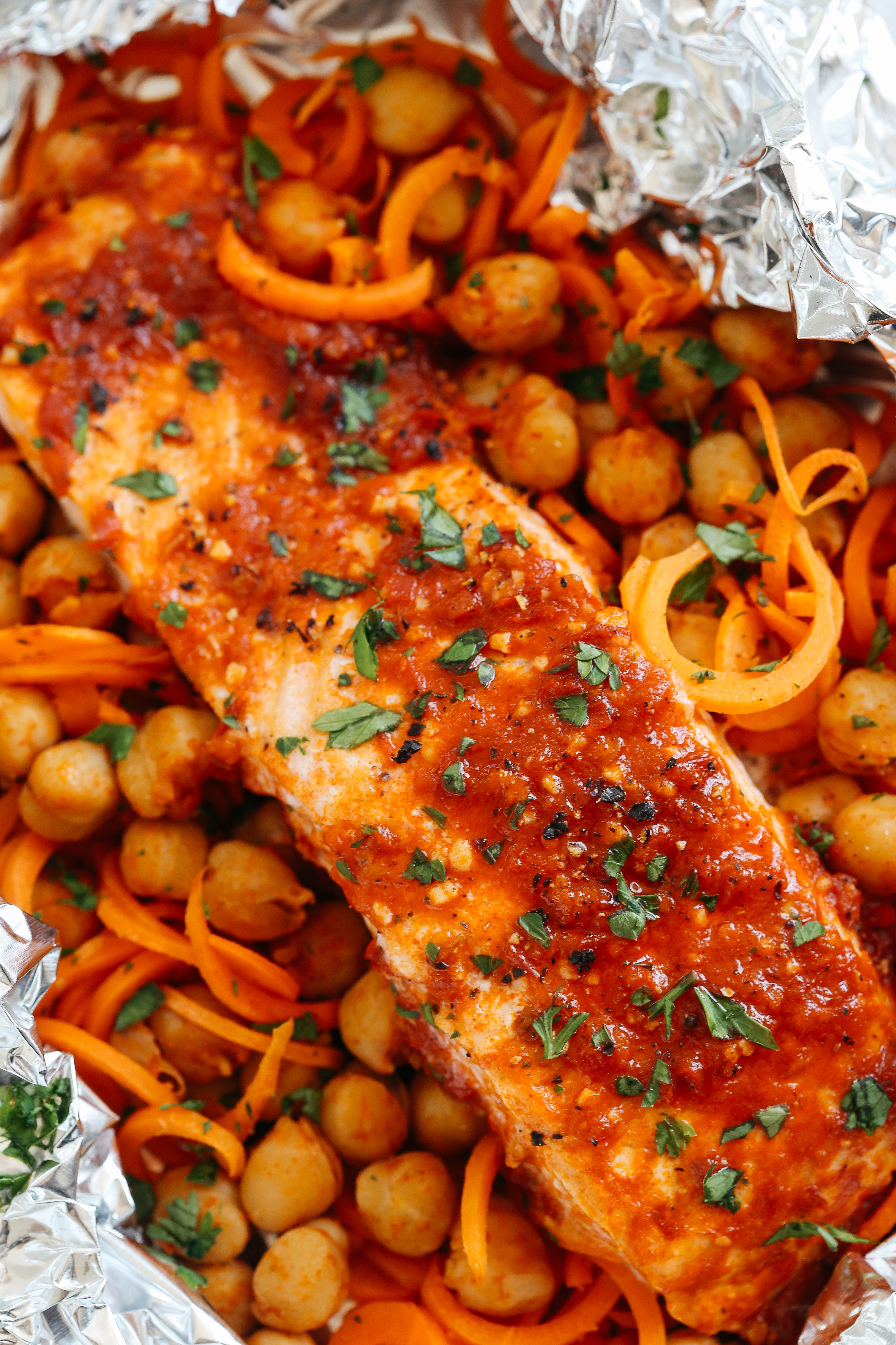 These Moroccan Salmon Foil Packets with Carrot Noodles & Chickpeas are sweet and spicy with tons of flavor and are easily made in just 20 minutes with little to no clean-up!