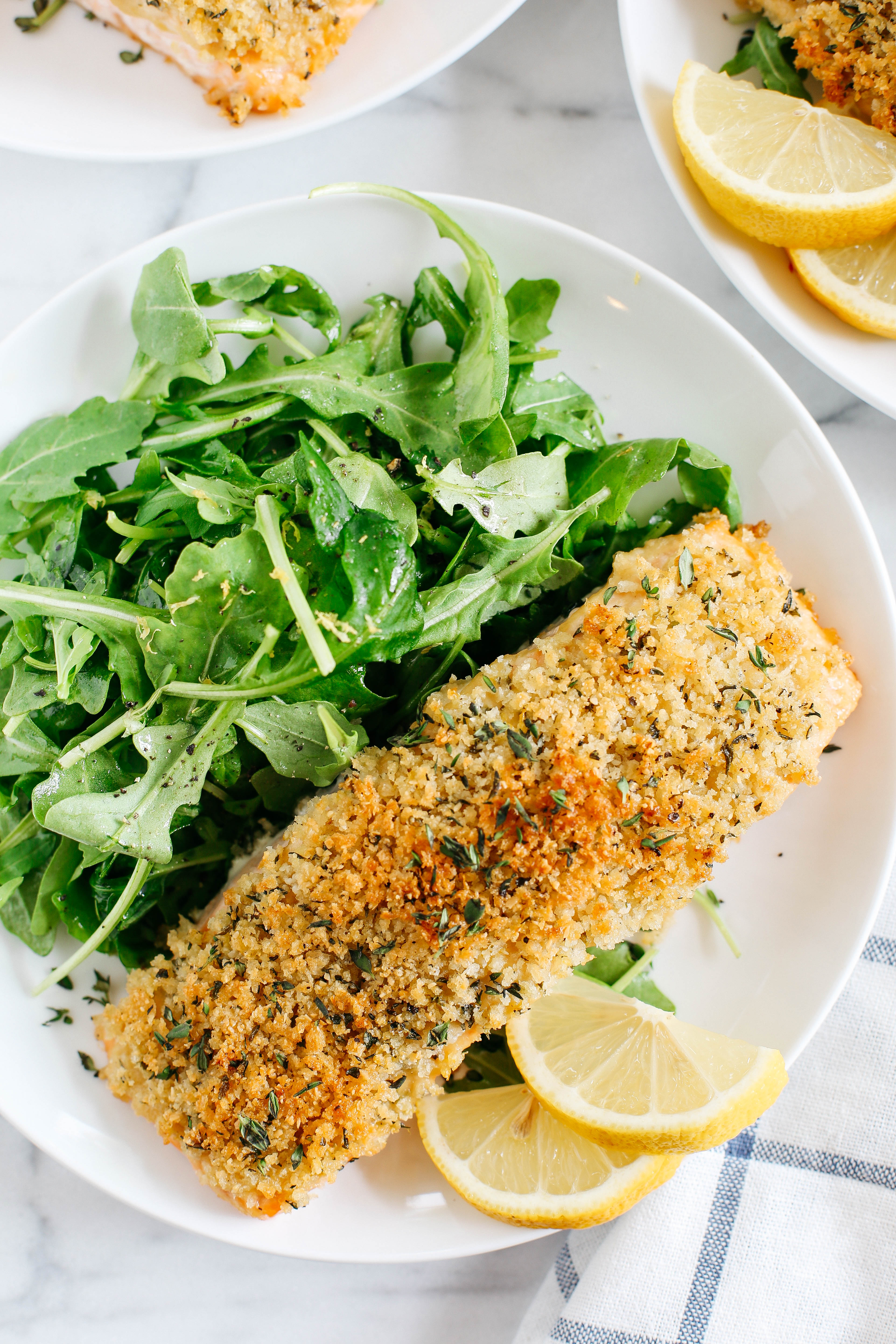 Hummus Crusted Salmon baked to perfection and served with a delicious Lemon Arugula Salad for the perfect healthy weeknight meal ready in under 30 minutes!