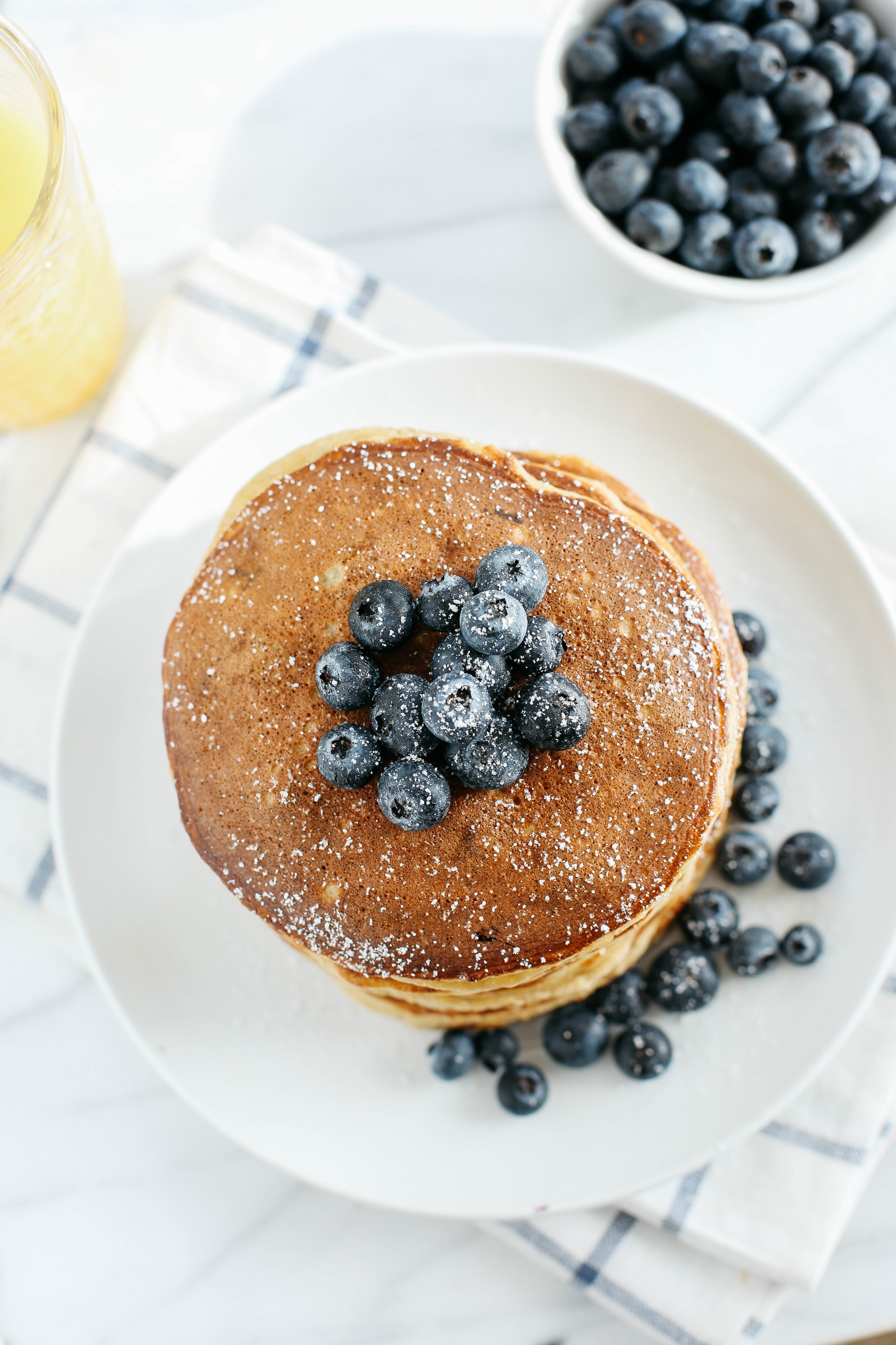 Start your morning with these fluffy blueberry banana pancakes that are grain-free, gluten-free and refined sugar-free and made with almond flour for an easy delicious breakfast!