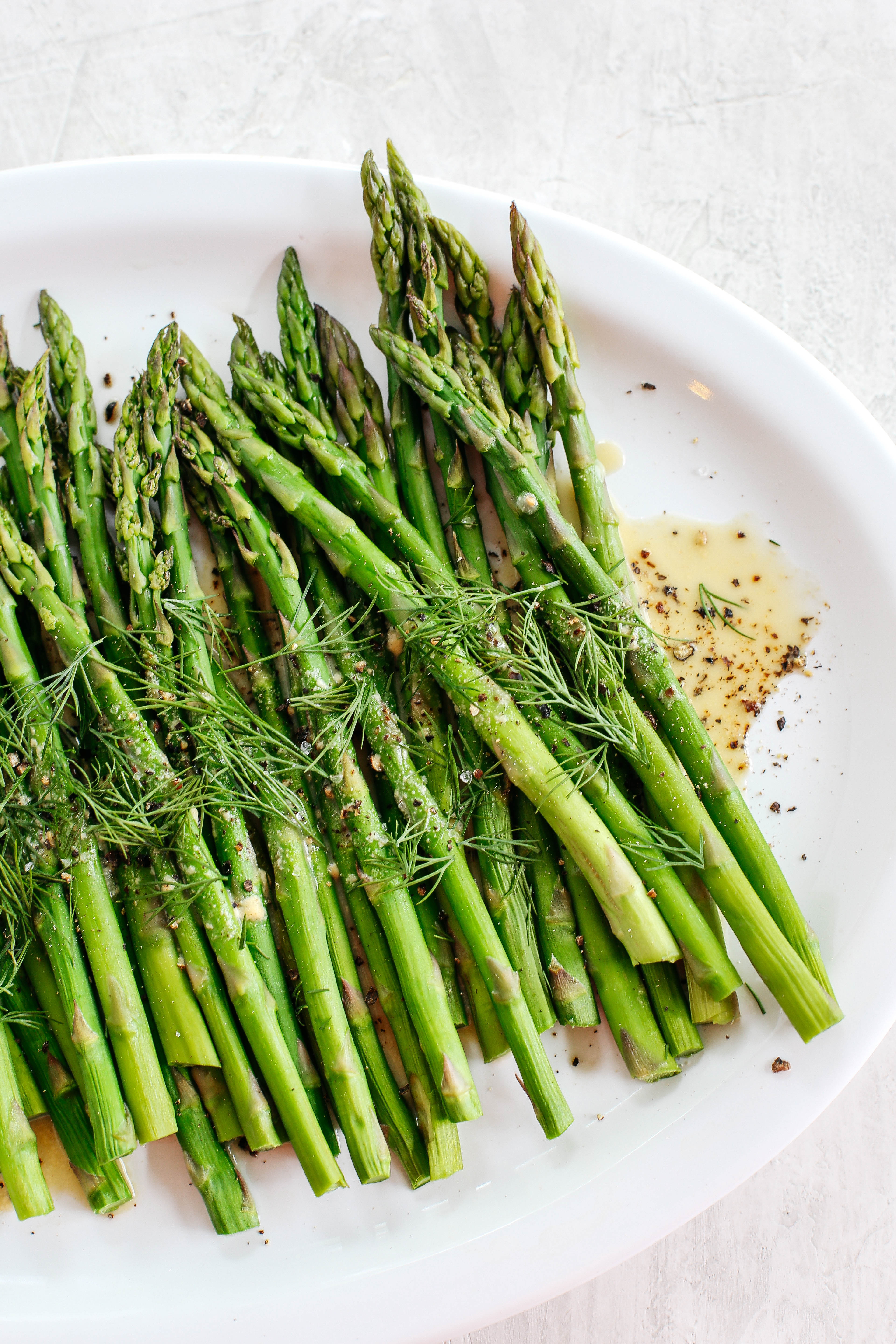 Baked Asparagus with delicious Mustard Dill Sauce makes the perfect healthy side dish for any meal with just a few simple ingredients!