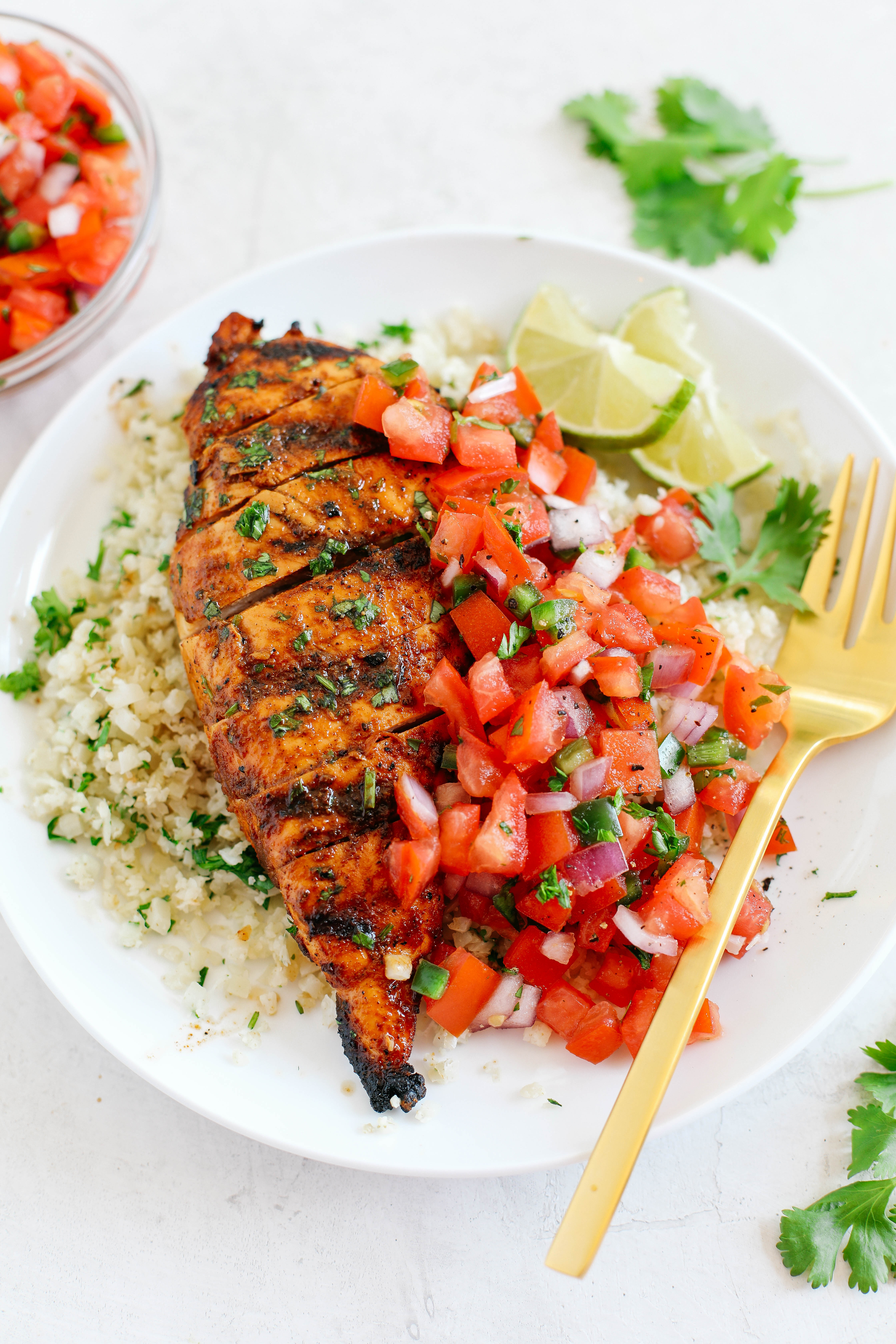 This Chili Lime Grilled Chicken is juicy, flavorful and marinated in a delicious combination of spices making this the perfect summer recipe!  Pair it with fresh salsa and cauliflower rice for a complete meal!