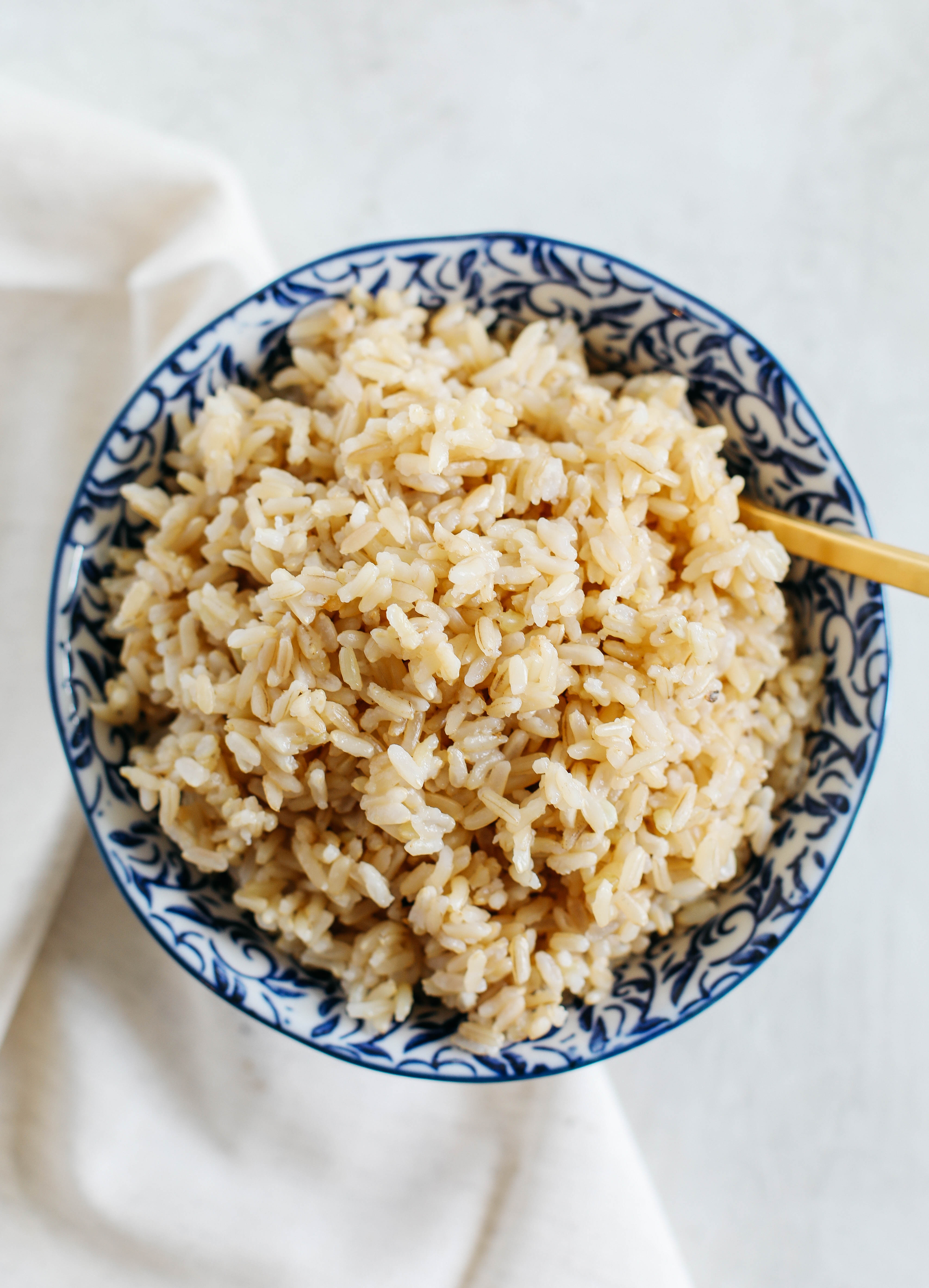 Perfectly cooked, fluffy brown rice EVERY TIME in about 30 minutes using the Instant Pot!  Hands down the easiest way to cook brown rice and perfect for meal prep!