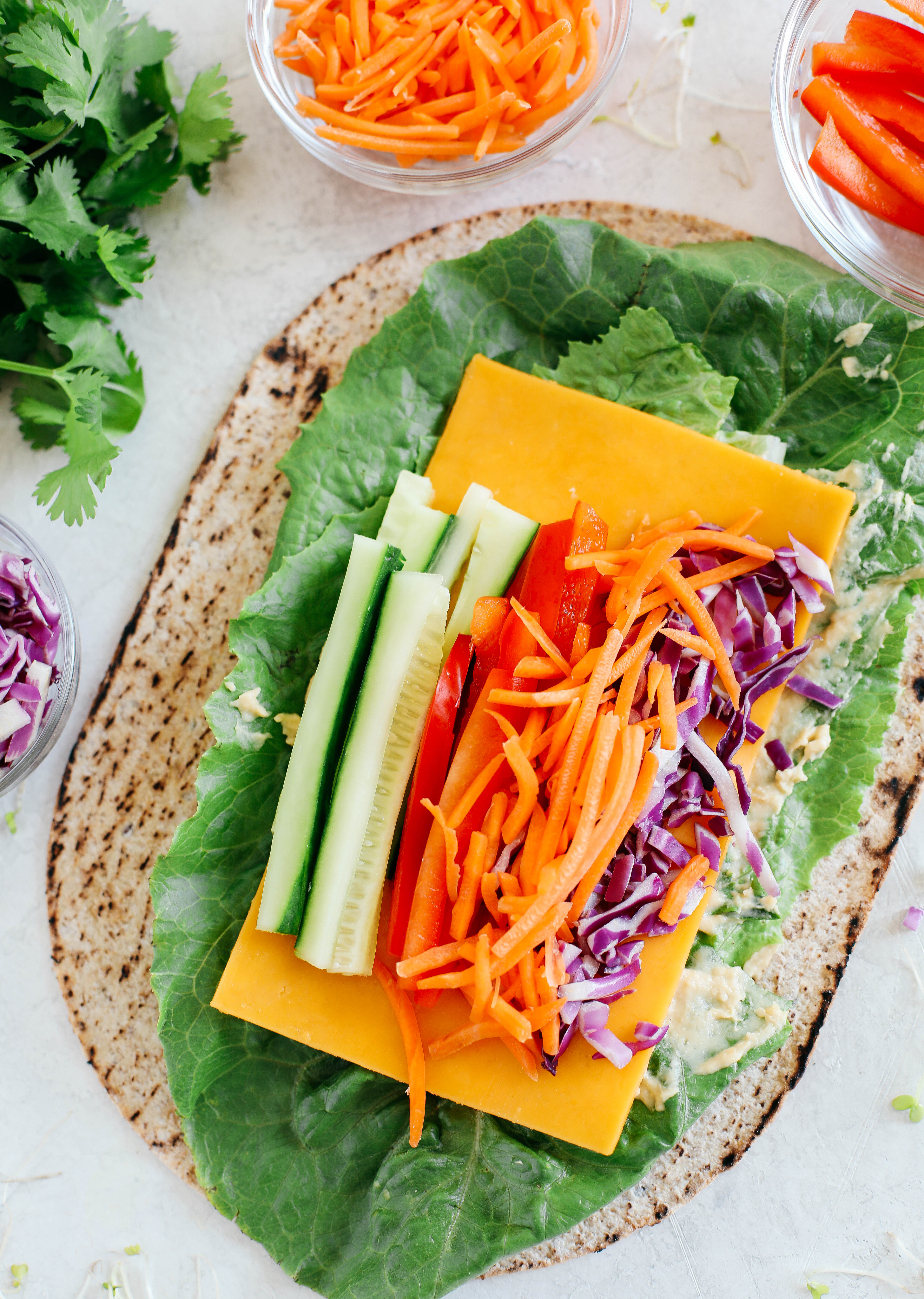 These colorful Rainbow Veggie Rolls are healthy, crunchy and loaded with tons of fresh veggies along with a delicious Ginger Avocado Dressing for dipping or drizzling!