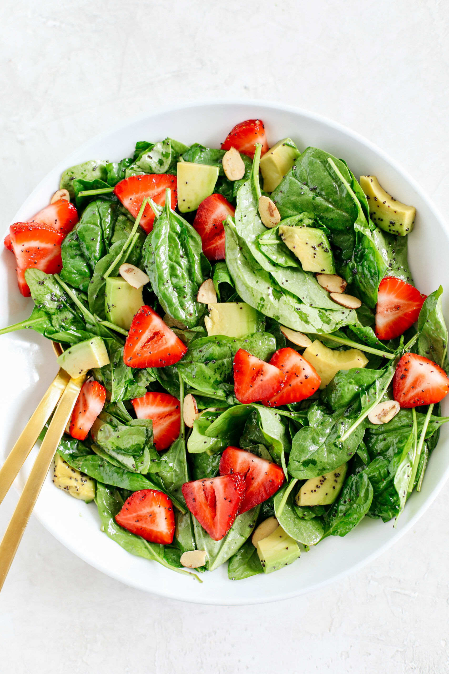 Super simple Strawberry Spinach Salad with Poppy Seed Dressing that is healthy, delicious and the perfect summer staple!