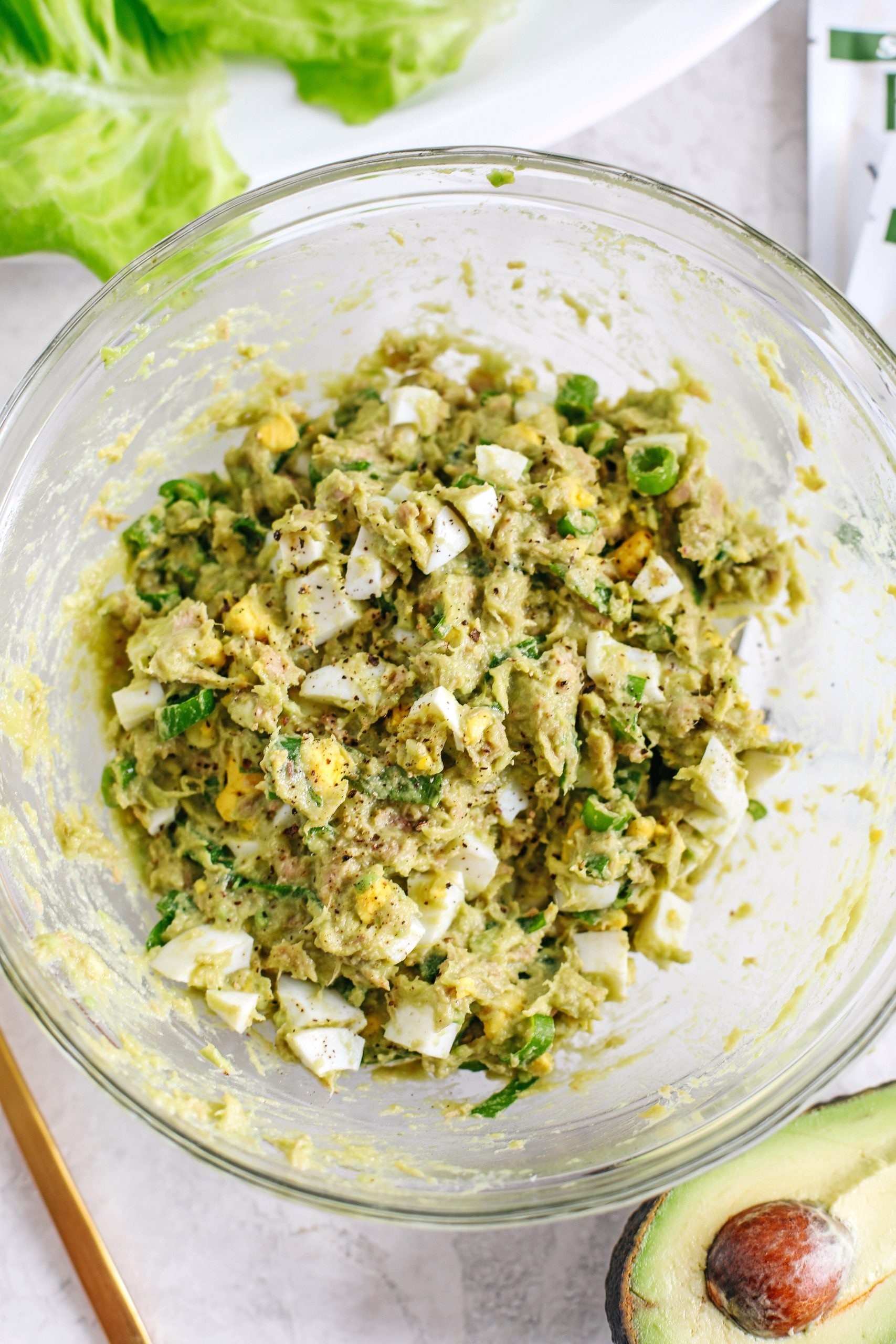 This 5-ingredient Tuna Avocado Egg Salad is fresh, delicious and only takes about 5 minutes to throw together for a healthy, protein-packed meal!  No mayo necessary!