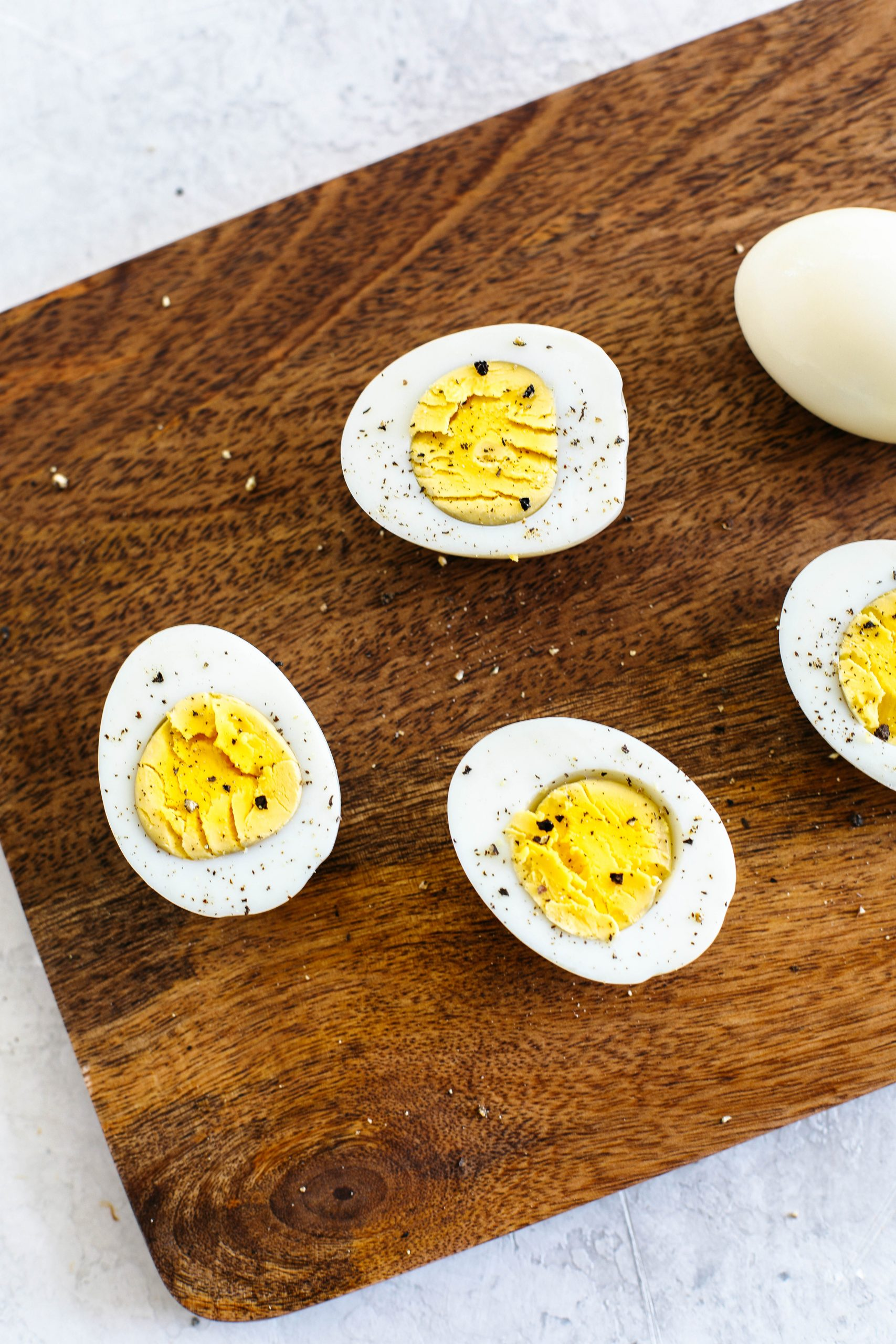 Perfectly cooked hard boiled eggs in the Instant Pot that are easy to peel and ready in just 15 minutes!  Hands down the easiest method and perfect for meal prep!