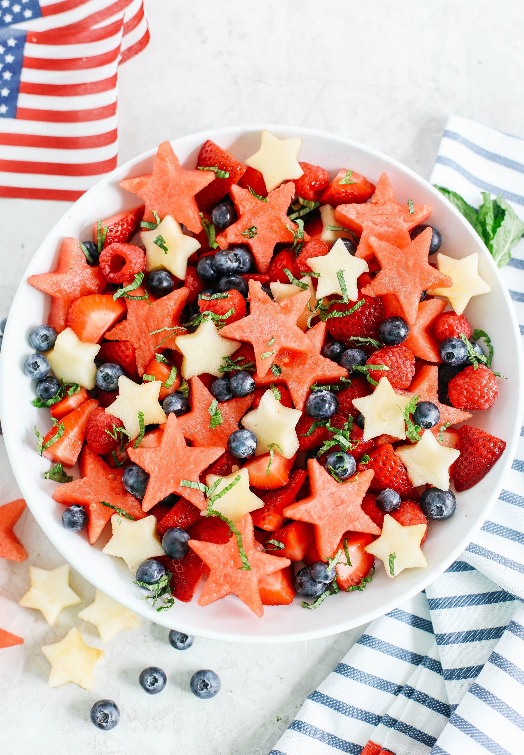 Kick off the 4th of July weekend with this fresh and festive Red, White and Blueberry Fruit Salad packed juicy watermelon, crisp apples and delicious berries all tossed together in a honey-citrus dressing!