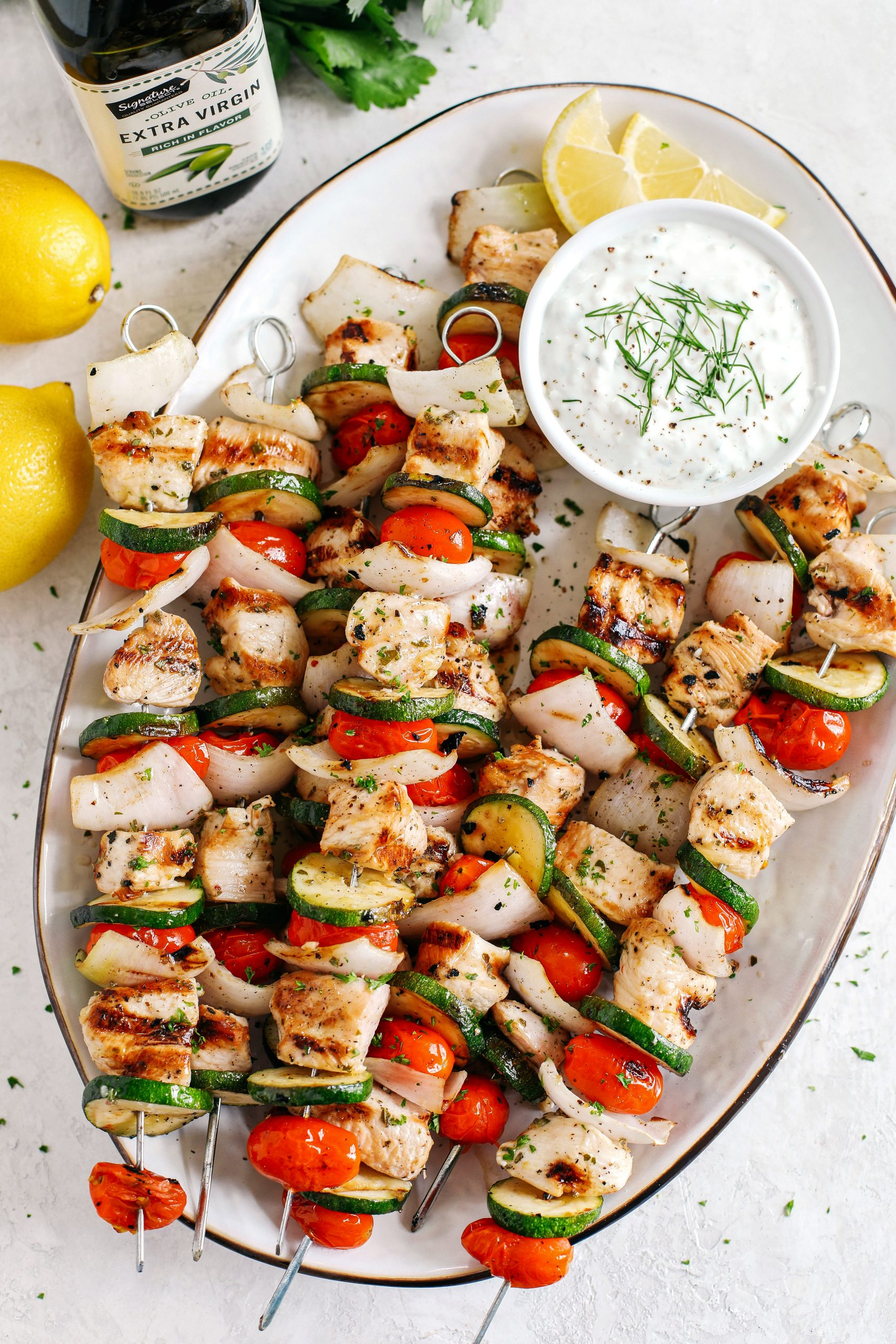 Super flavorful Greek Chicken Kabobs marinated with zesty lemon juice, garlic and fresh herbs and served with the most delicious homemade tzatziki dipping sauce!