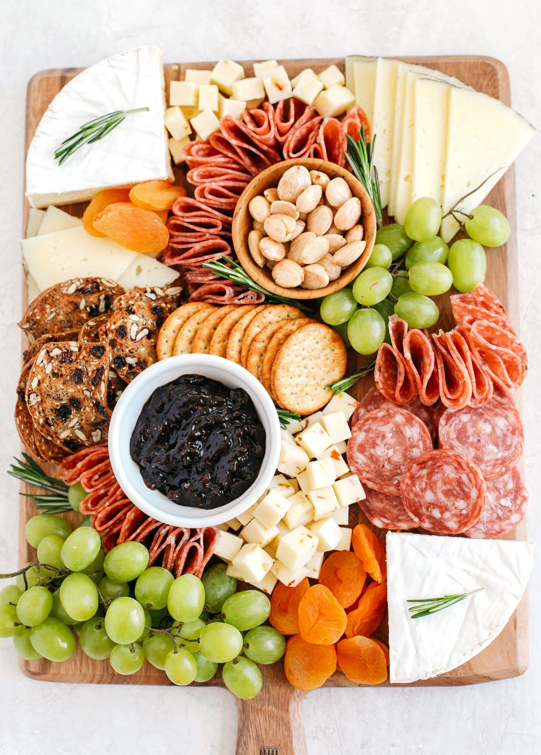 My favorite tips and tricks for building a perfect cheeseboard with all your favorite charcuterie that is simple, beautiful and made in just minutes!