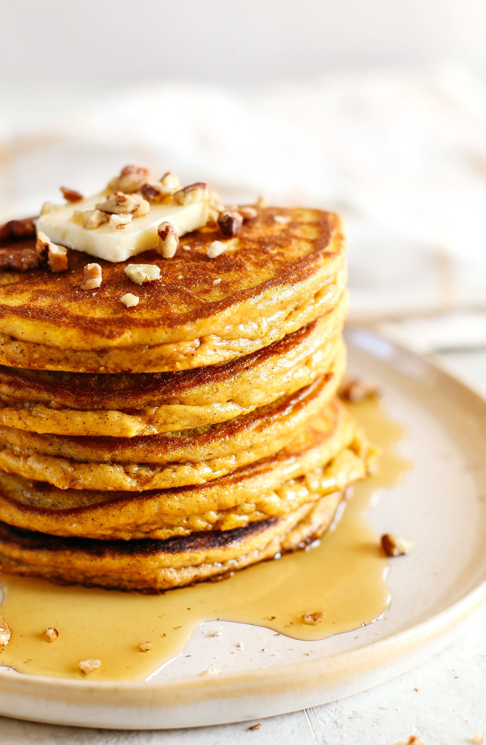 Start your morning with these fluffy pumpkin pancakes that are gluten-free, dairy-free and paleo with zero refined sugars made with almond flour for an easy delicious fall breakfast!
