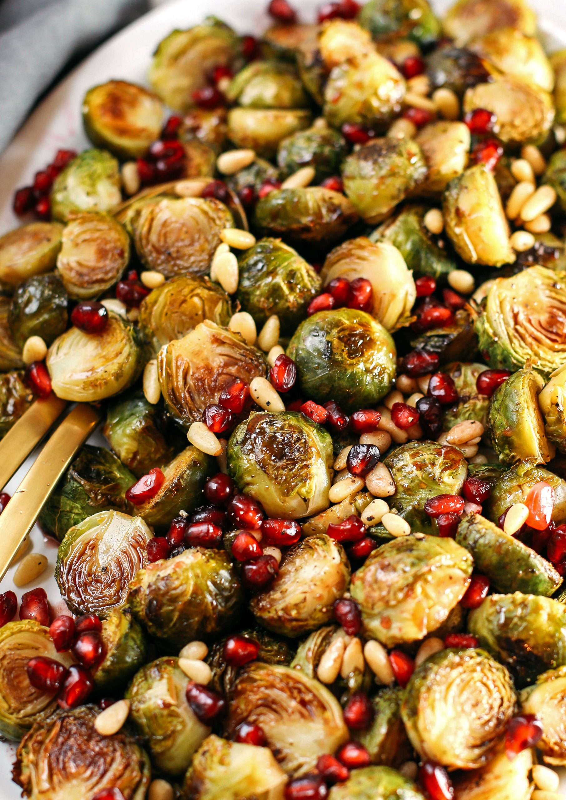 These Pomegranate Glazed Brussels Sprouts are savory, sweet and roasted to perfection making them the perfect holiday side dish for your table this season!