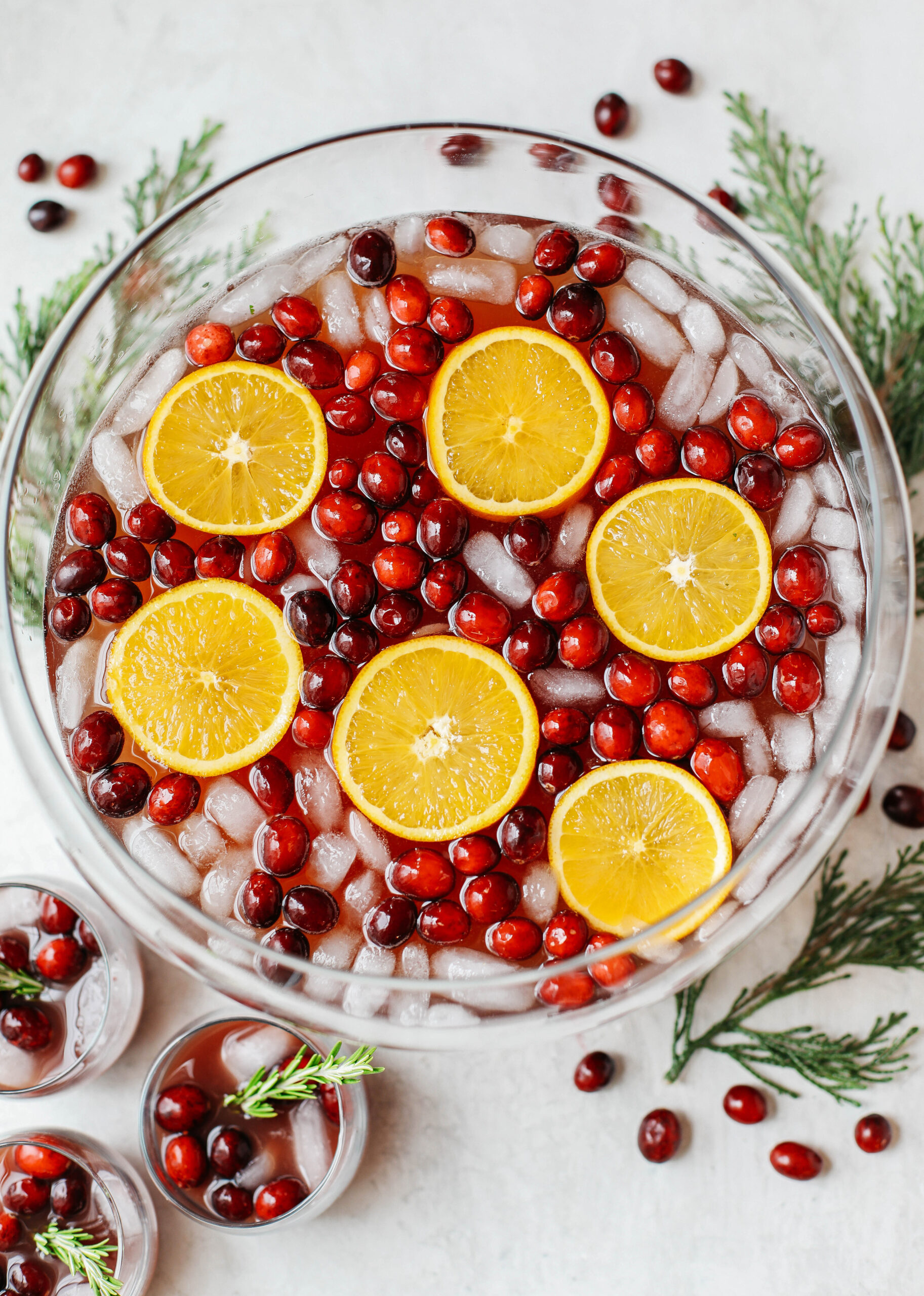 This Sparkling Christmas Punch makes the perfect addition to any holiday party or gathering with a delicious blend of cranberries and oranges all marinated together in one festive cocktail!