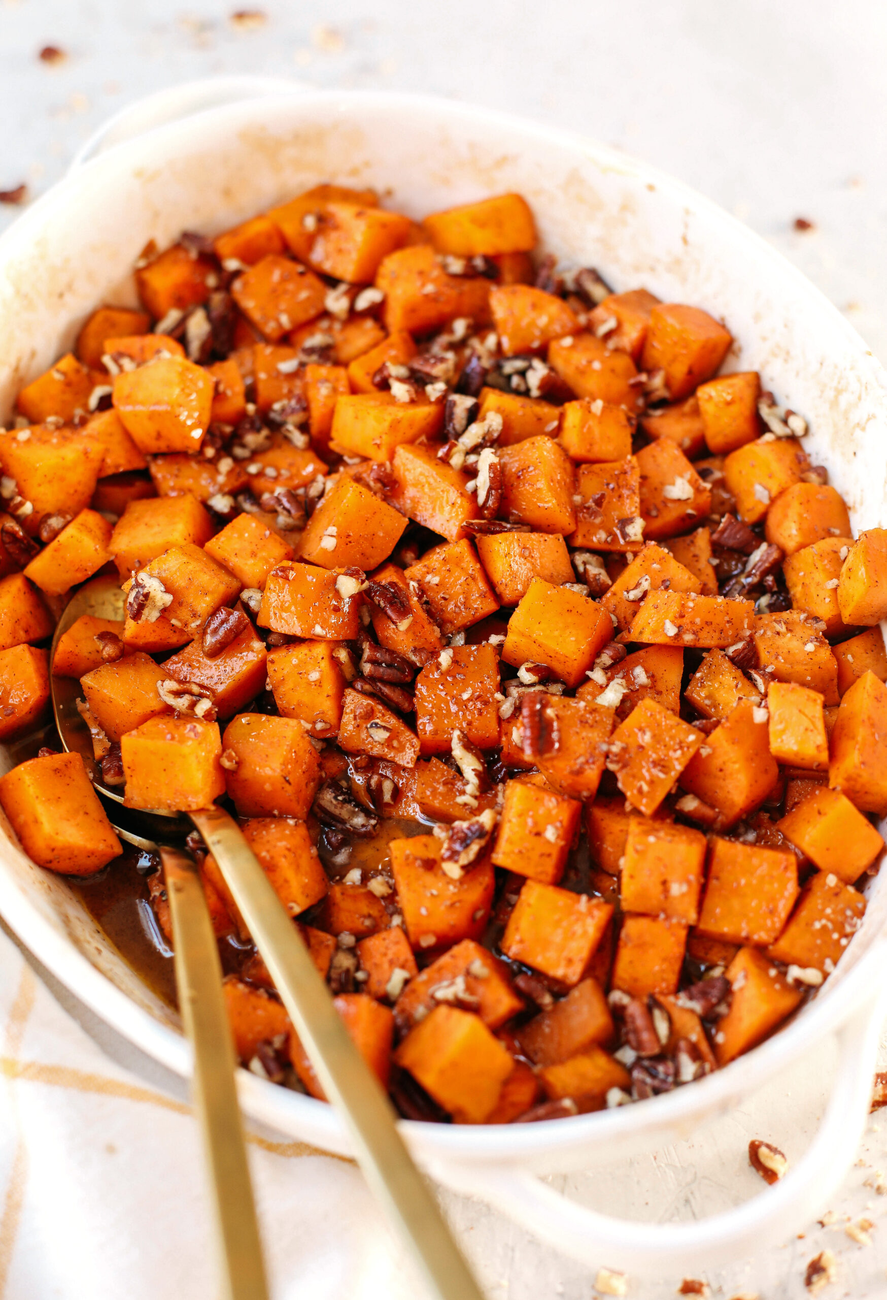 These Bourbon Maple Pecan Sweet Potatoes are one of my favorite holiday side dishes coated in the most delicious maple cinnamon glaze that will keep you coming back for seconds!
