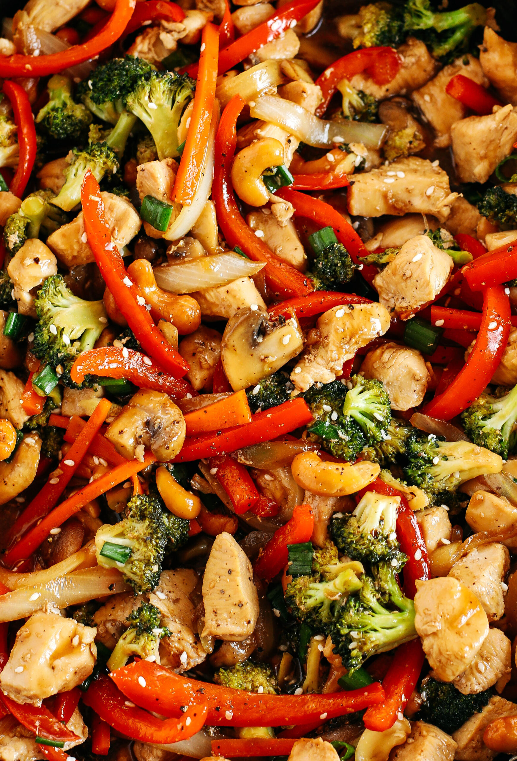 This Teriyaki Chicken Stir Fry is the perfect weeknight meal that is quick and easy to make, full of fresh veggies and tossed together in a delicious homemade teriyaki sauce!