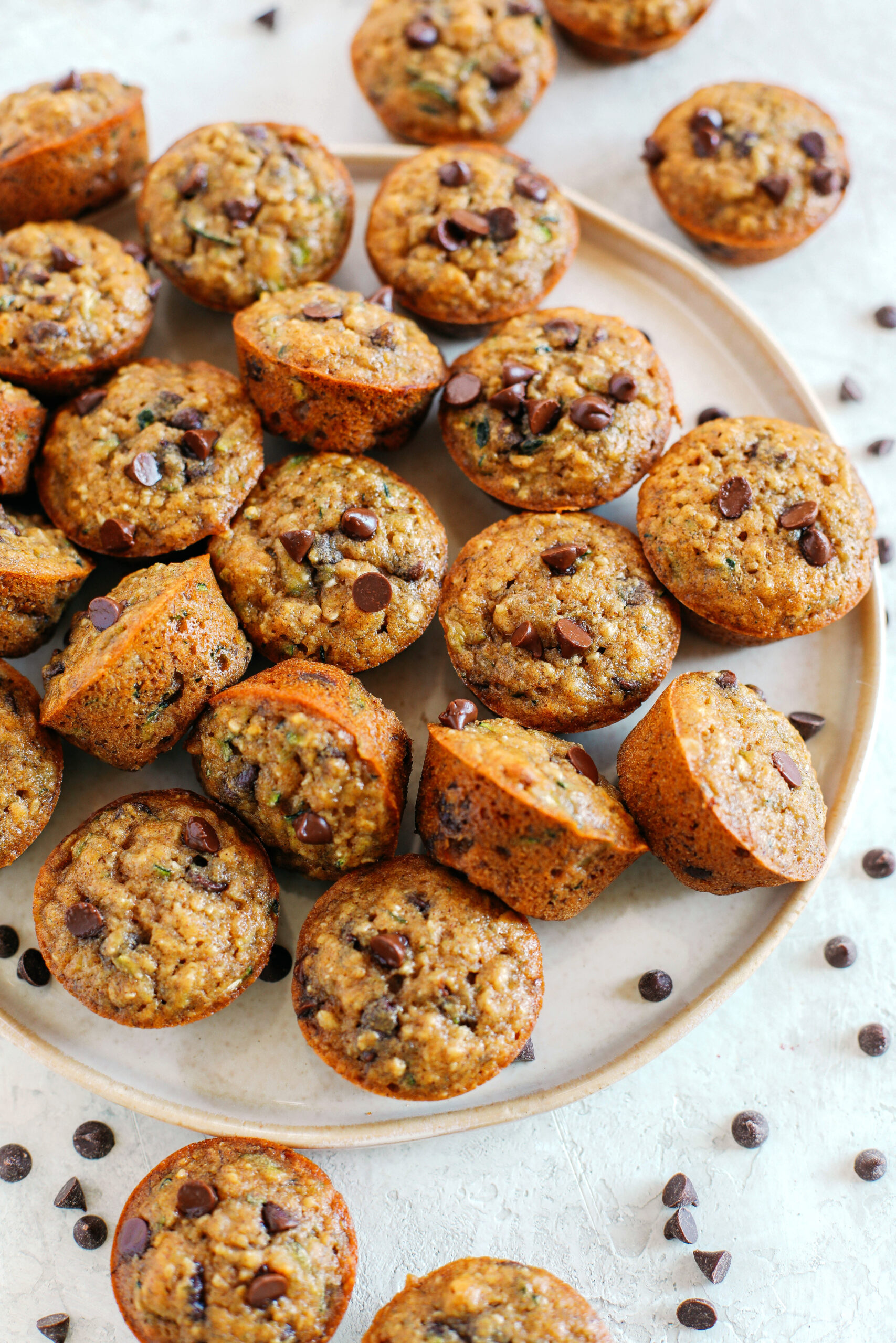 Healthy bite-sized Chocolate Chip Banana Zucchini Muffins that are moist and delicious with hidden veggies and naturally sweetened with banana and honey!