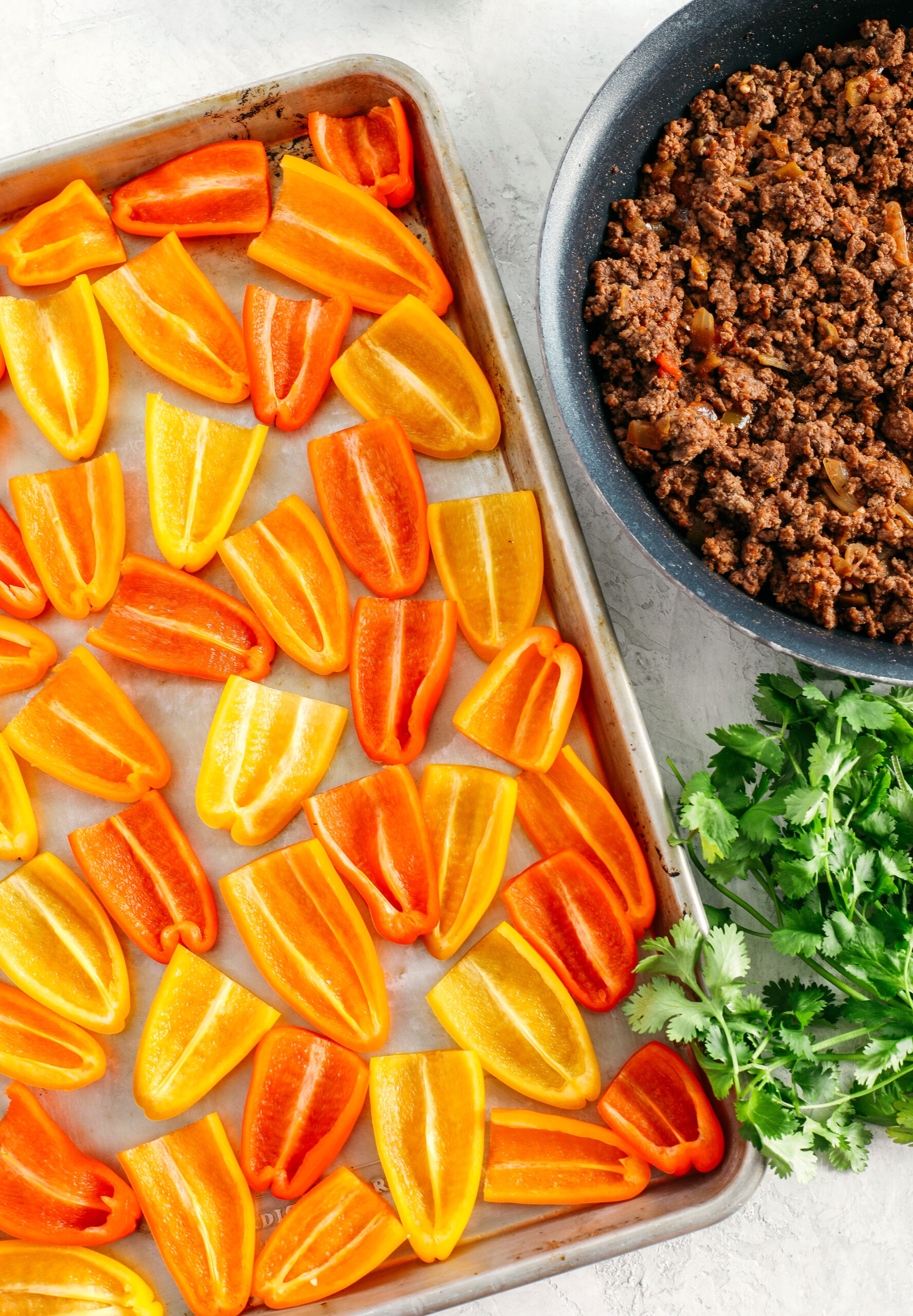 These Sheet Pan Loaded Bell Pepper Nachos are packed with all your favorite flavors and fun toppings making them the perfect low carb appetizer to enjoy on game day!