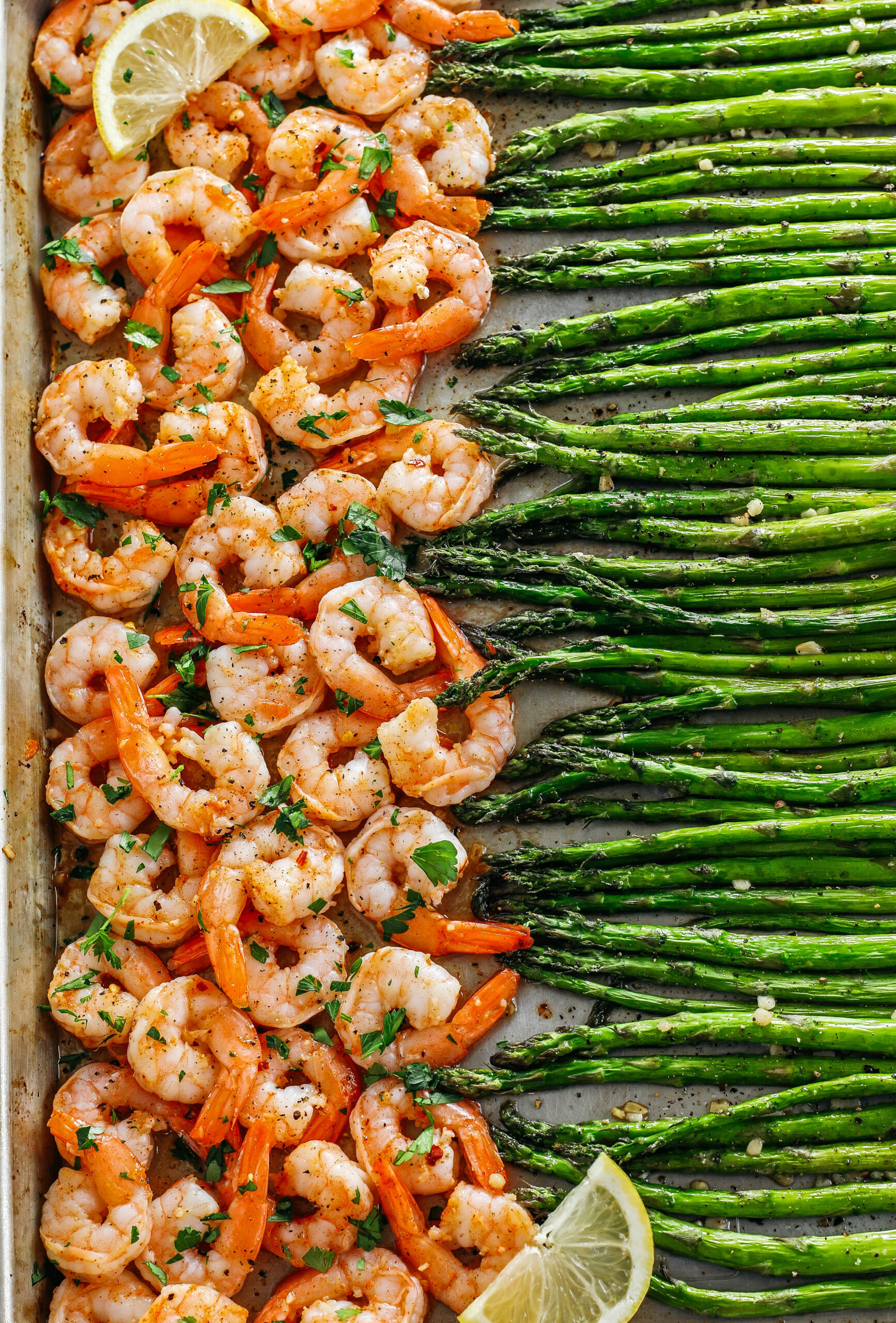 This Sheet Pan Lemon Garlic Shrimp and Asparagus is the perfect weeknight dinner loaded with flavor and easily made all in one pan in under 20 minutes!