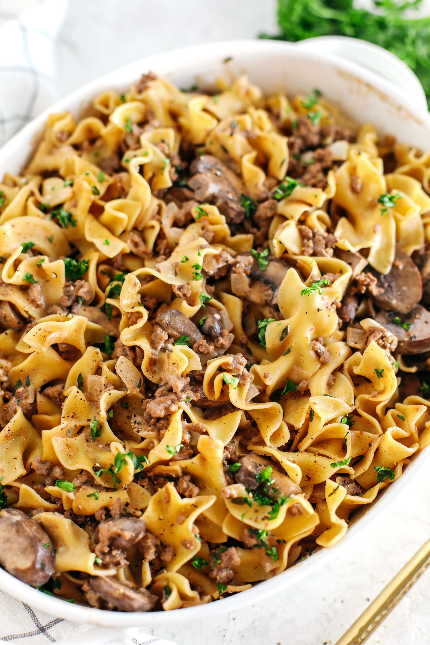 This Easy Beef Stroganoff Casserole is the ultimate family-friendly comfort food! The perfect weeknight meal made with egg noodles and smothered in the most delicious creamy mushroom sauce in just 30 minutes!