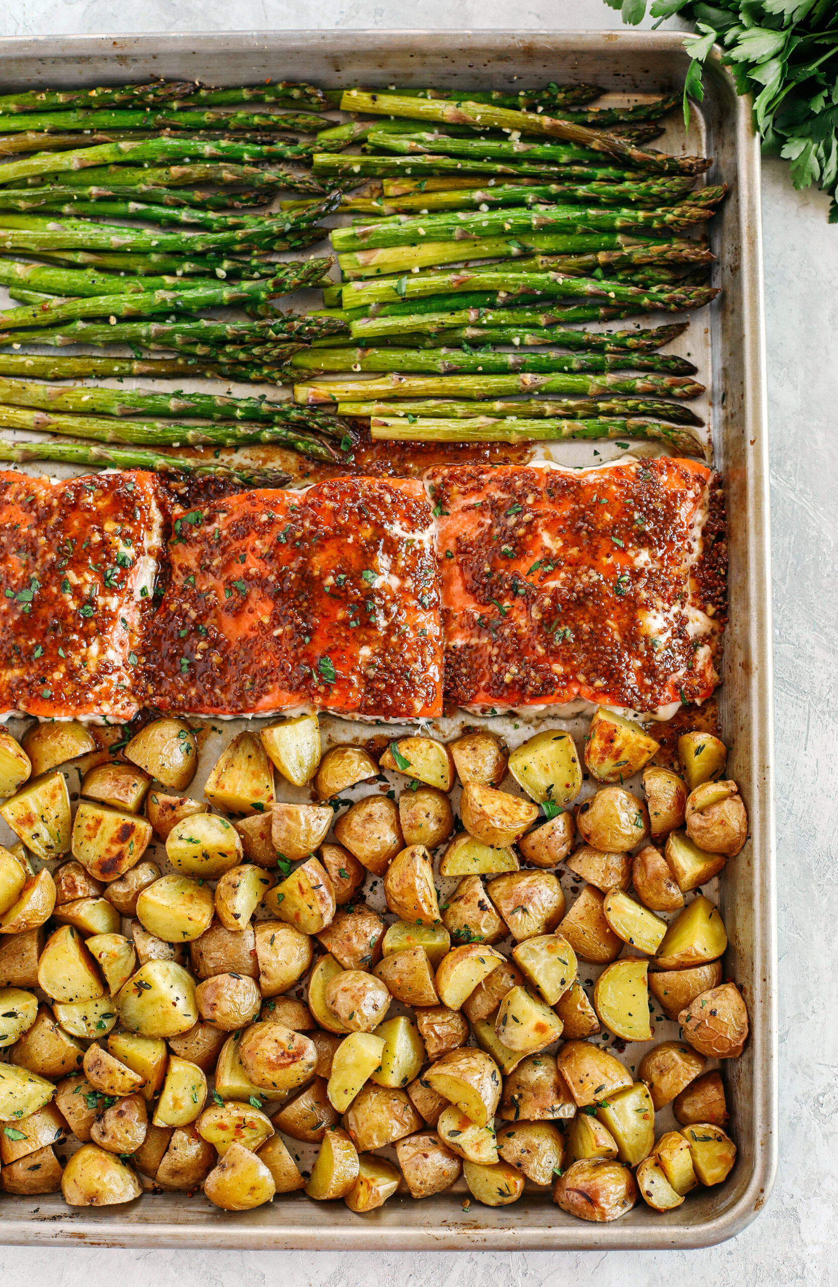 Sheet Pan Maple Dijon Glazed Salmon with roasted asparagus and tender seasoned potatoes make the perfect weeknight dinner that is easily made all in one pan in just 30 minutes!