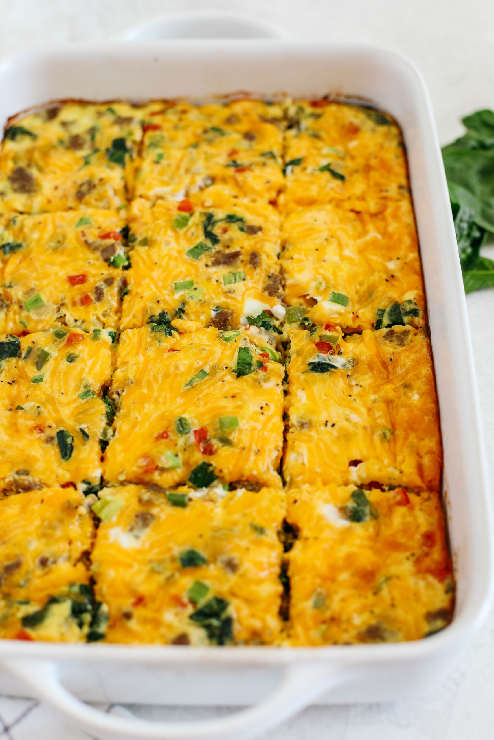 This Sausage and Veggie Egg Casserole makes the perfect low carb savory breakfast loaded with your favorite veggies, leafy greens, and delicious turkey sausage that is sure to be a crowdpleaser!