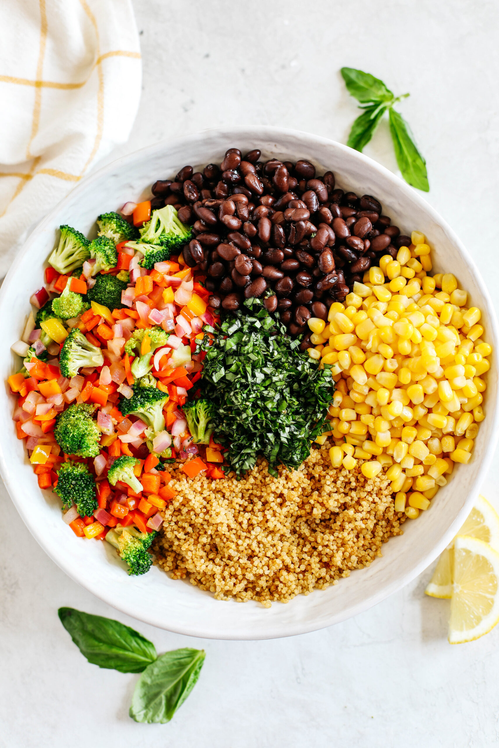 The perfect Summer Quinoa Salad made with a delicious combination of sautéed veggies, black beans, corn, and fresh basil all tossed with a lemon balsamic dressing!