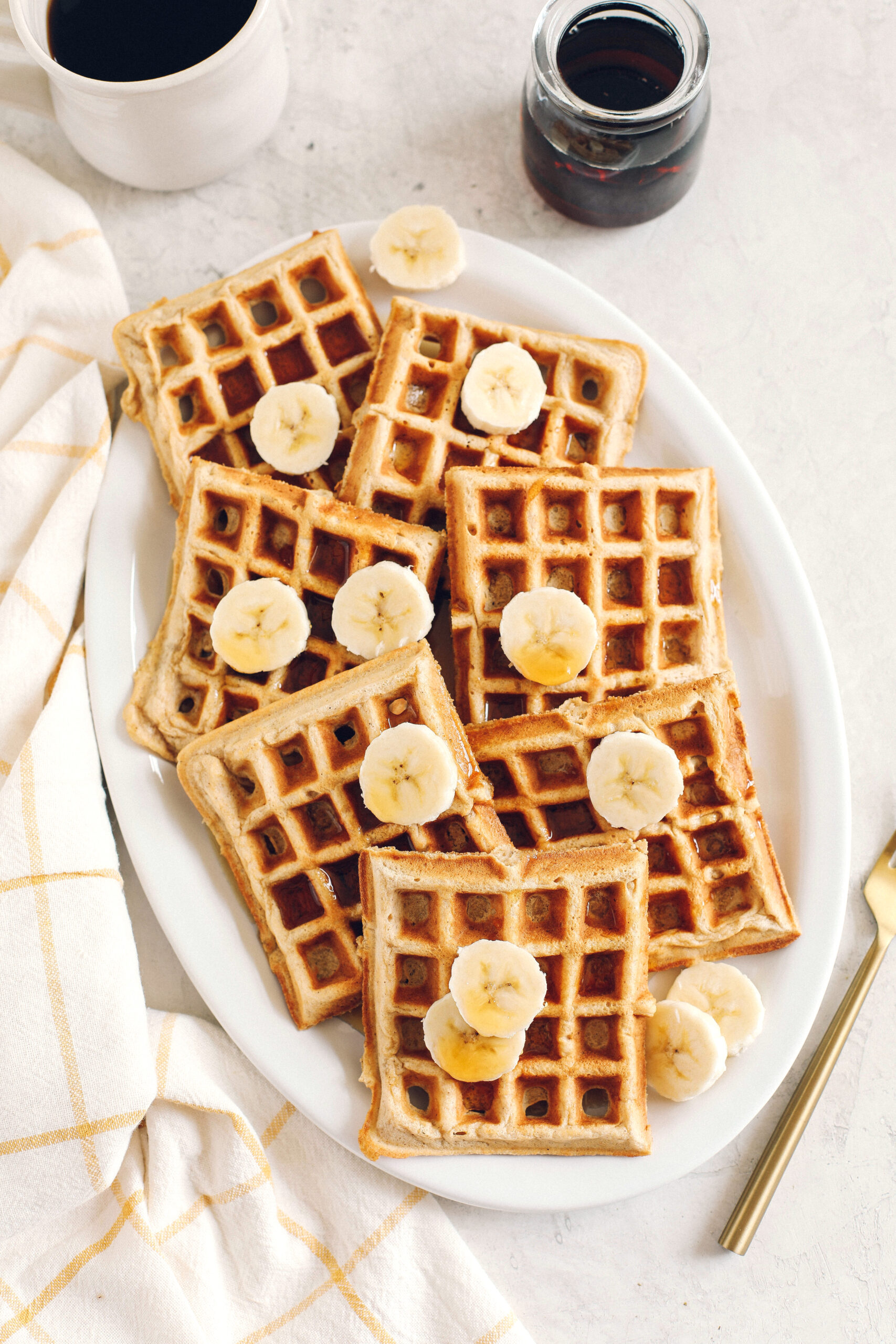 Light and fluffy Whole Wheat Banana Waffles with perfectly crisp edges, warm spices and made with zero refined sugar for the perfect healthy morning breakfast!