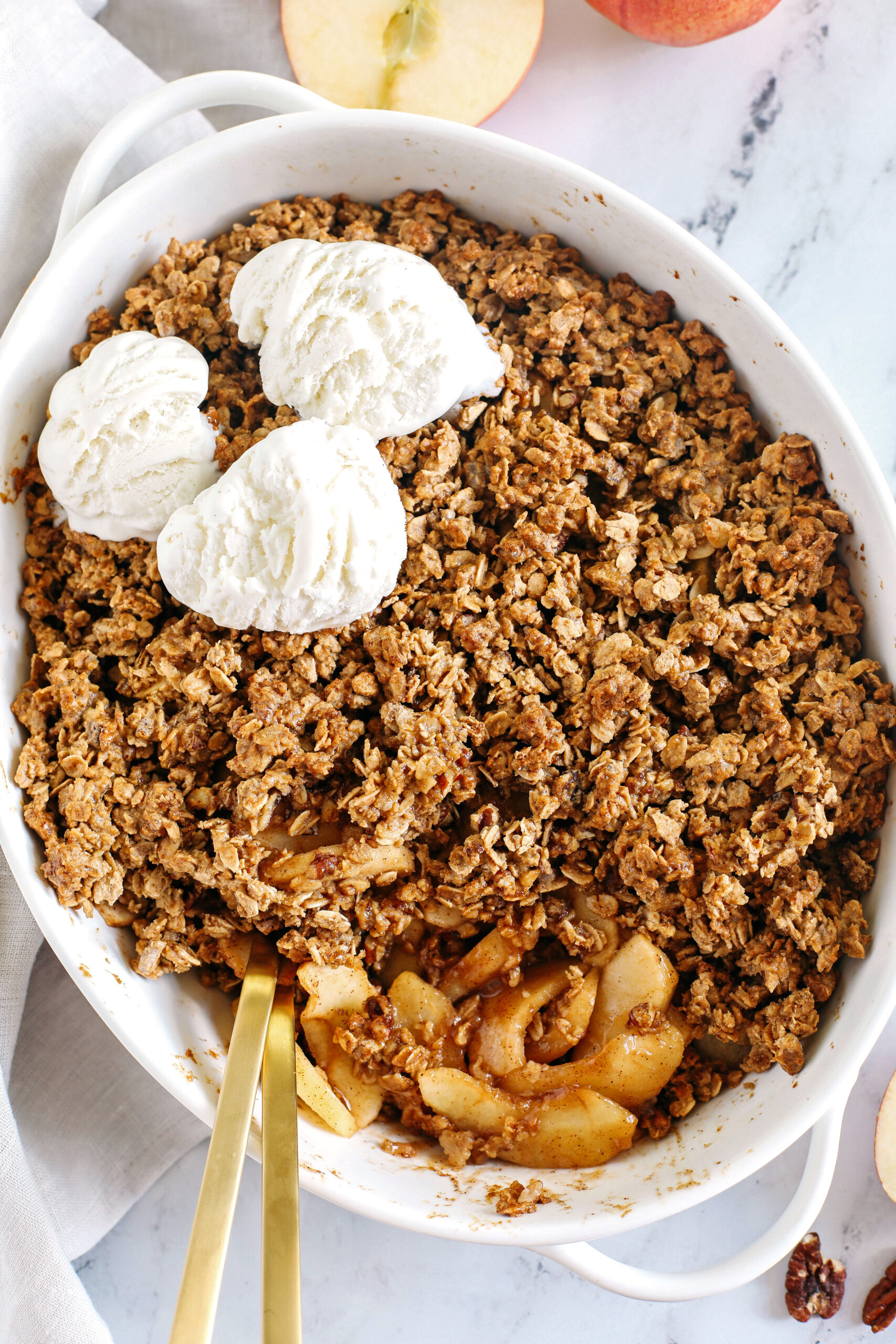 This Healthy Apple Crisp is loaded with tender apples and warm spices, naturally sweetened with maple syrup, all topped with a crunchy oatmeal pecan topping!
