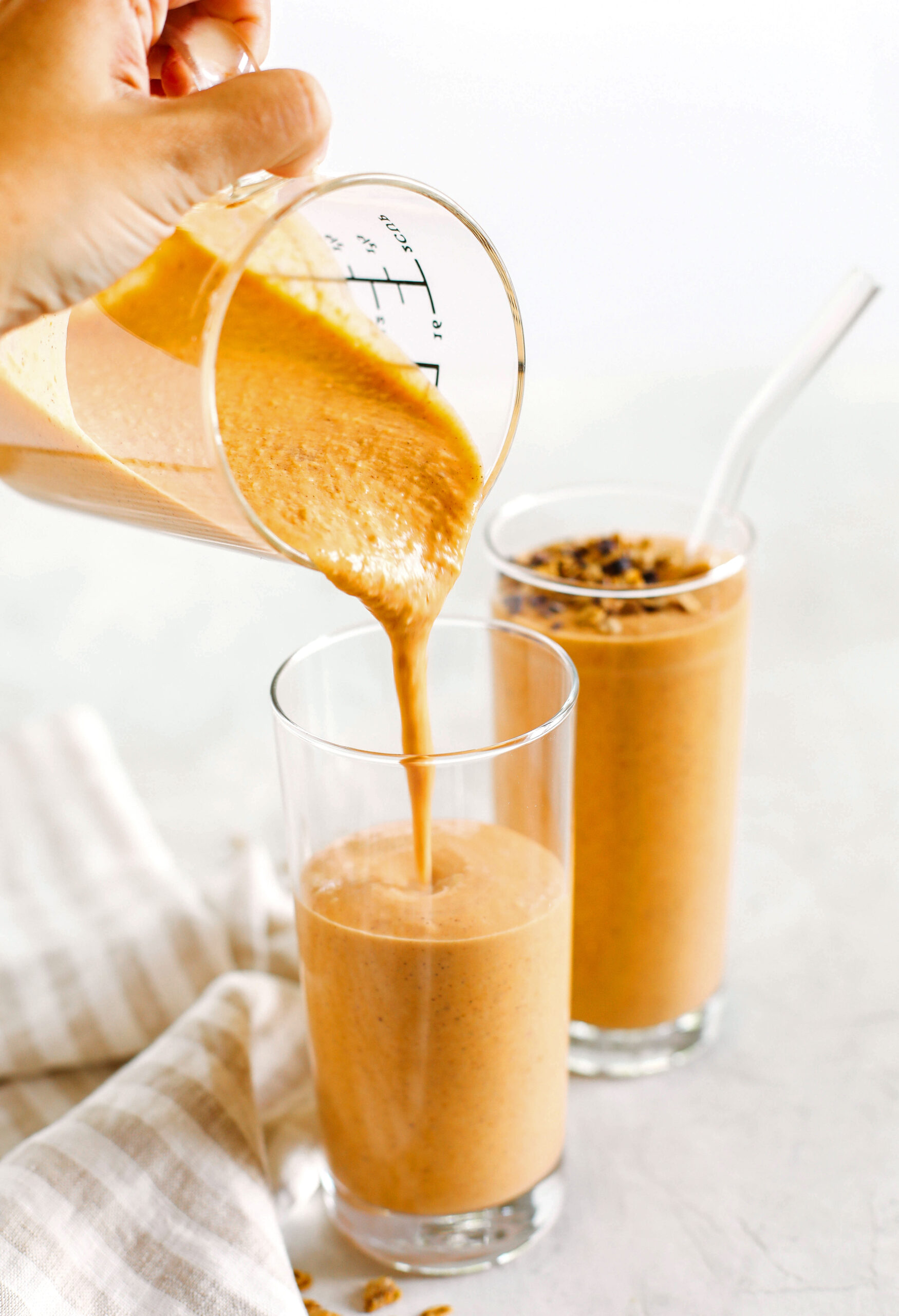 Start your morning off with this thick and creamy Pumpkin Spice Smoothie that is healthy, delicious and loaded with all your fall favorites like pumpkin, apple, banana, Greek yogurt, maple syrup and warm spices!