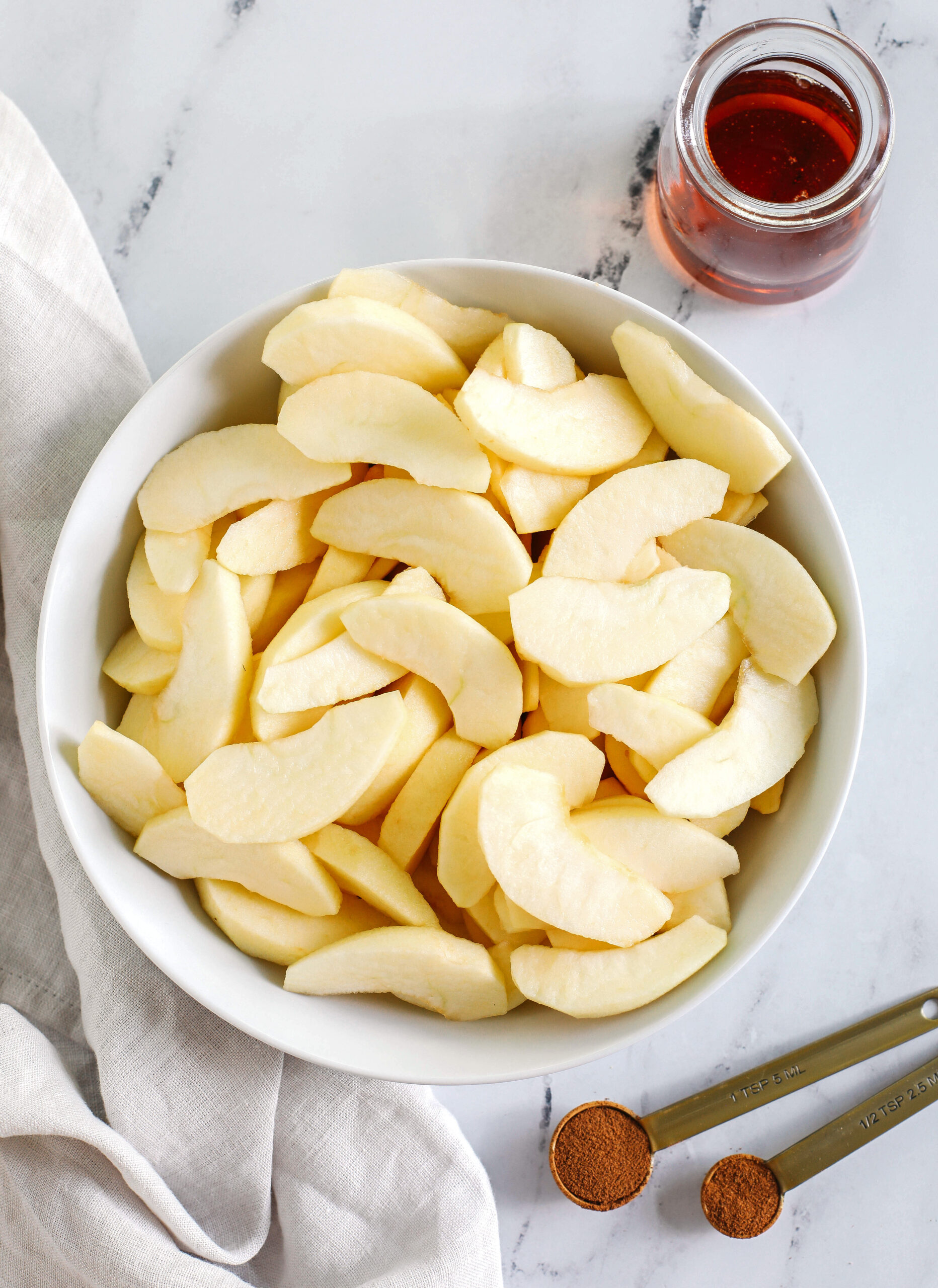 Quick and EASY Maple Cinnamon Sautéed Apples make the perfect dessert topped with ice cream, a delicious snack all on its own, or served with oatmeal, waffles, and pancakes!